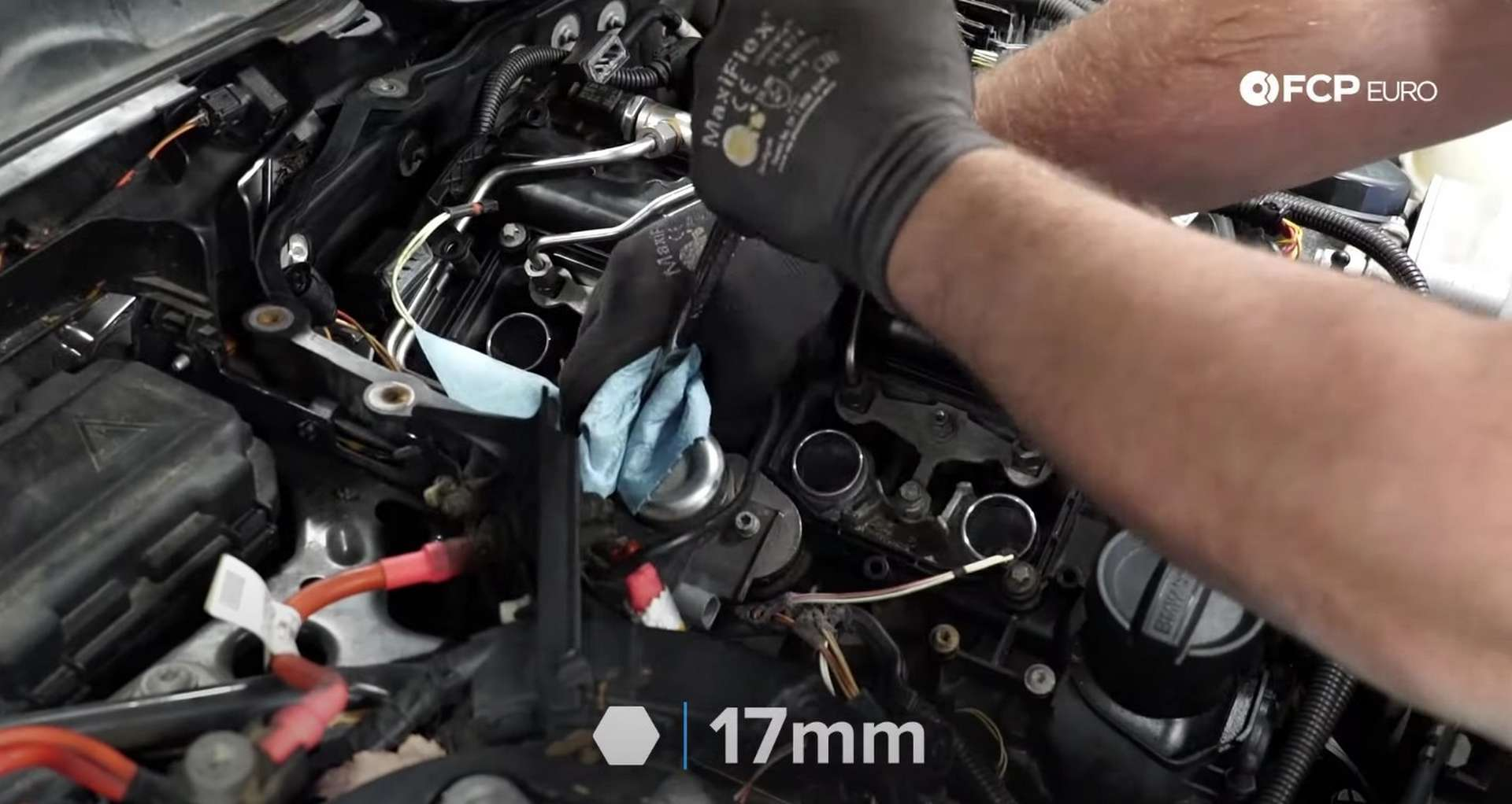 DIY BMW F30 High-Pressure Fuel Pump Replacement disconnecting the high-pressure feed line from the pump