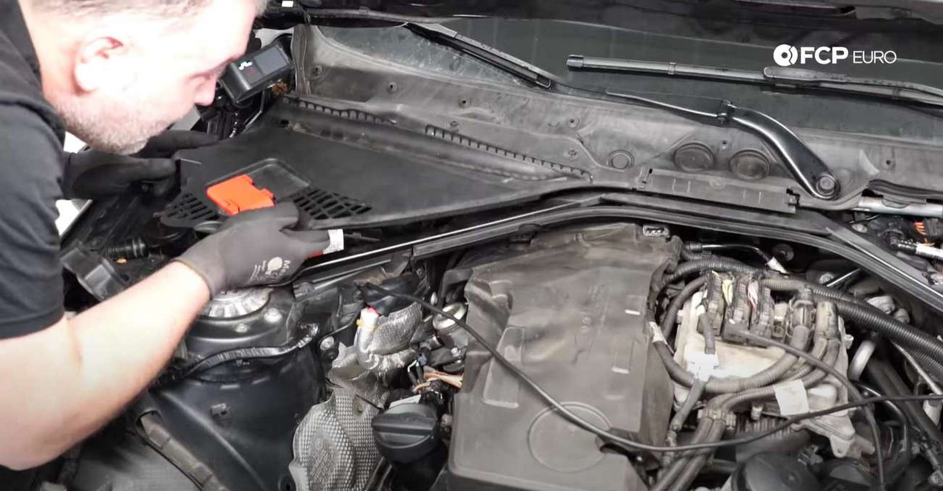 DIY BMW F30 High-Pressure Fuel Pump Replacement refitting the upper cowl pieces
