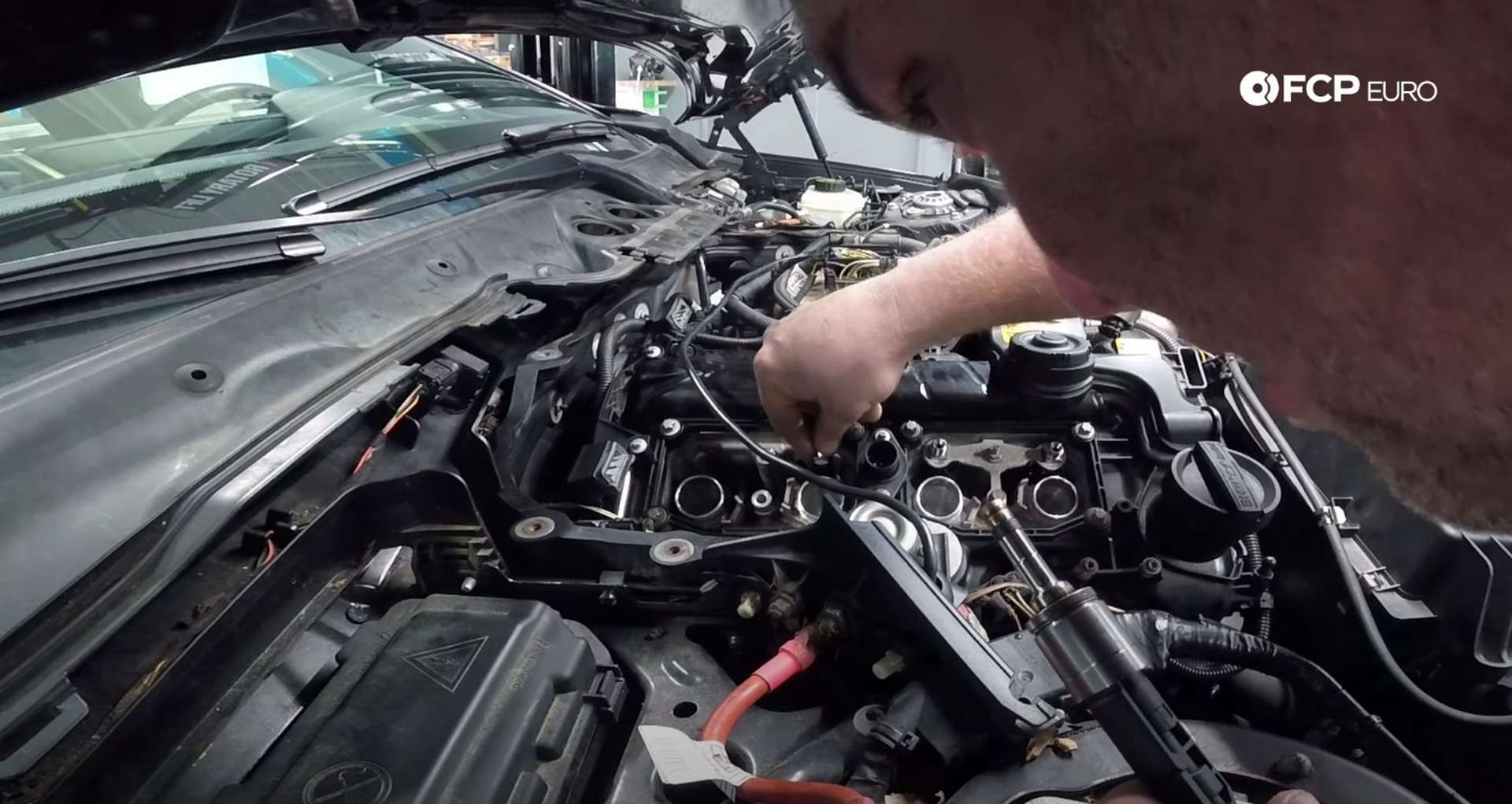 DIY BMW F30 Fuel Injector Replacement placing the injector in the head
