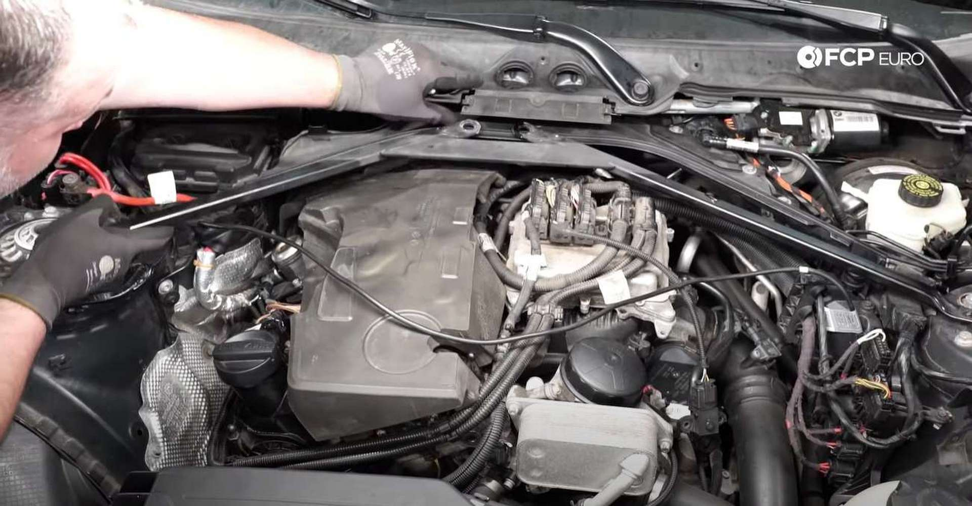 DIY BMW F30 Fuel Injector Replacement refitting the strut tower brace