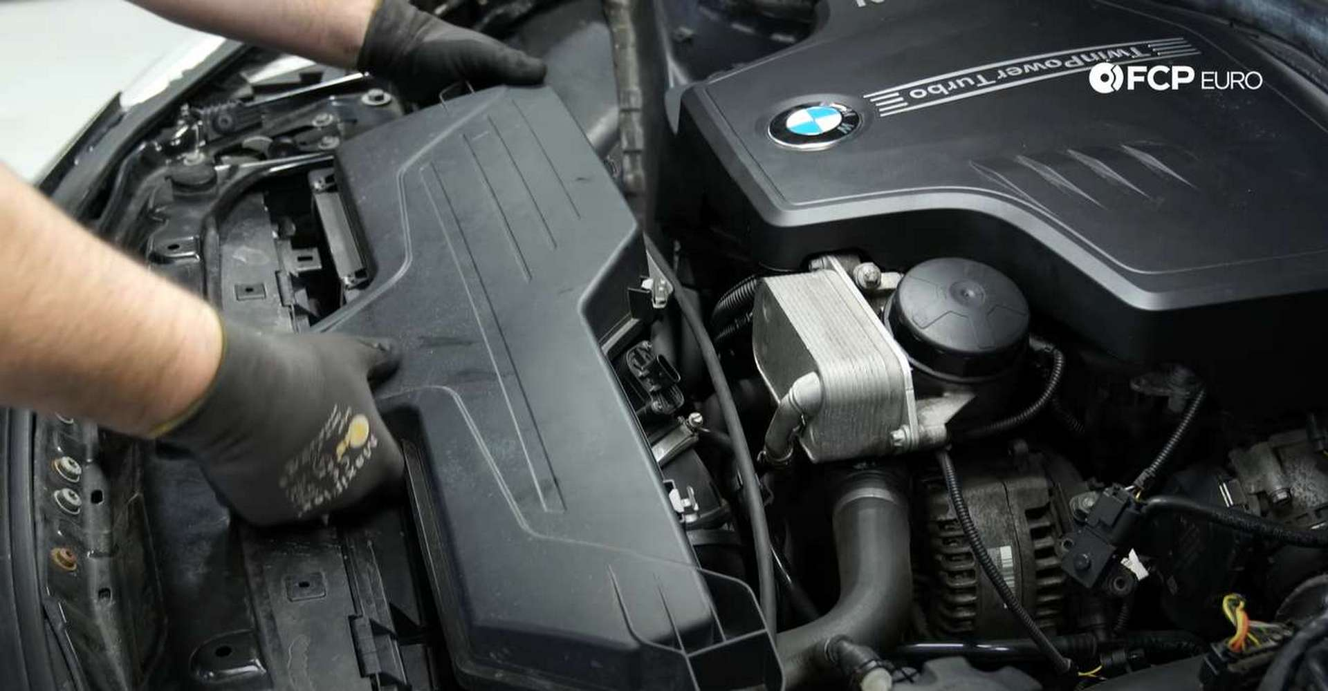 DIY BMW F30 Serpentine Belt Replacement pulling out the airbox