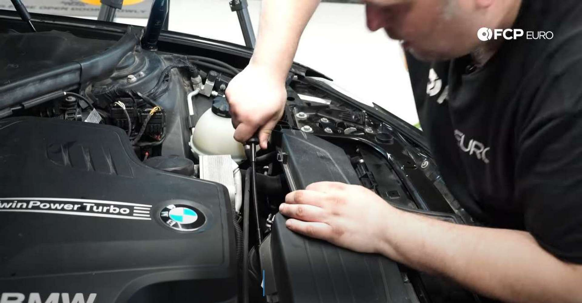 DIY BMW F30 Serpentine Belt Replacement tightening the airbox hose clamp