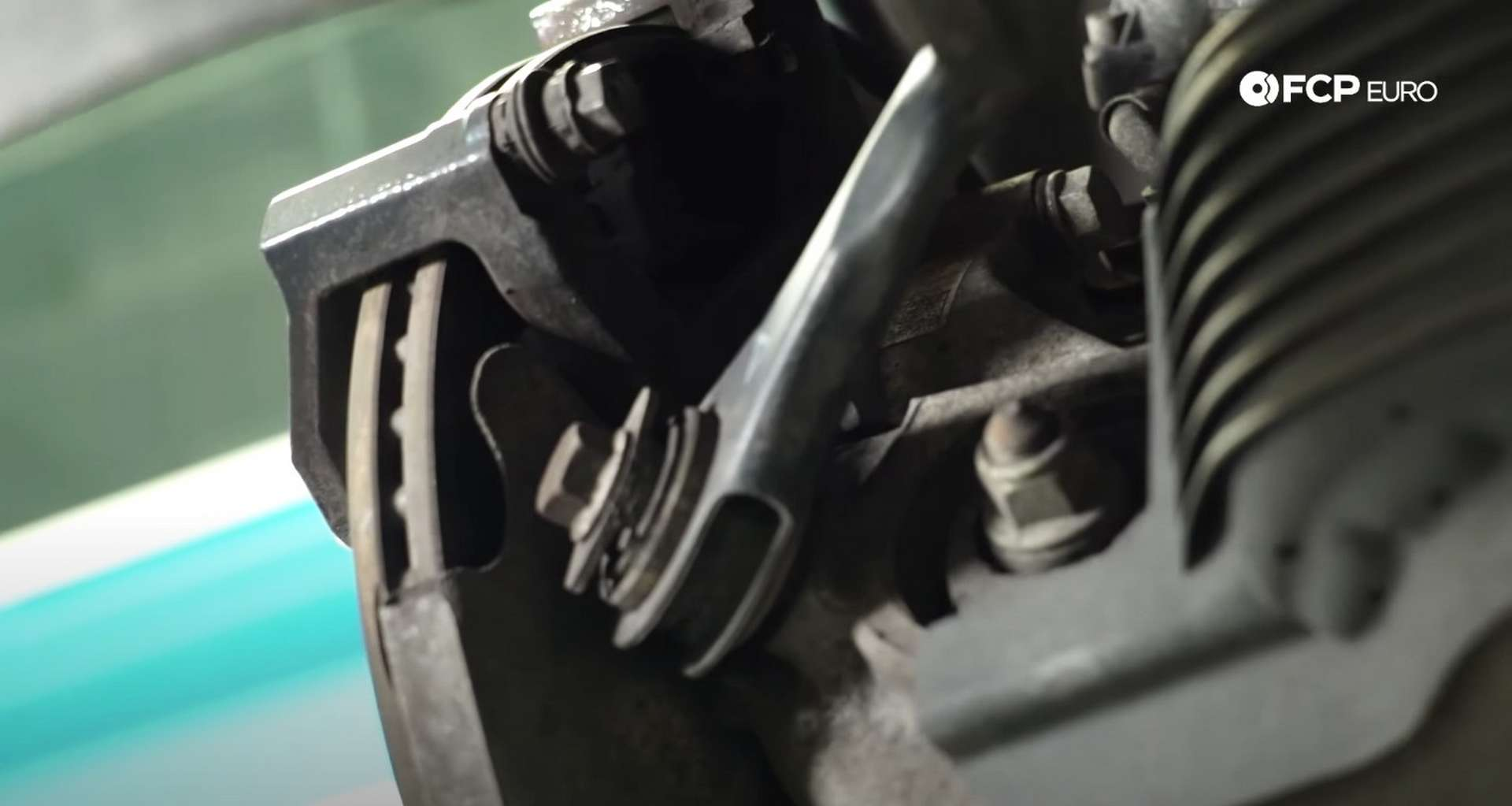 DIY Audi B8 S4 Rear Brake Service caliper bracket bolt location