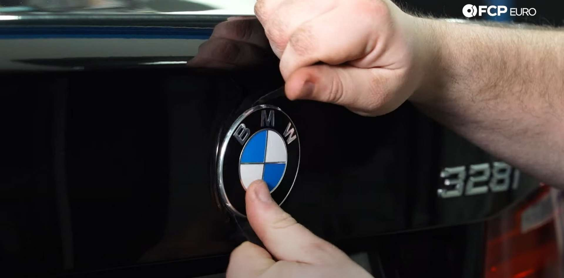 DIY BMW F30 Roundel Replacement pulling off the trunk badge