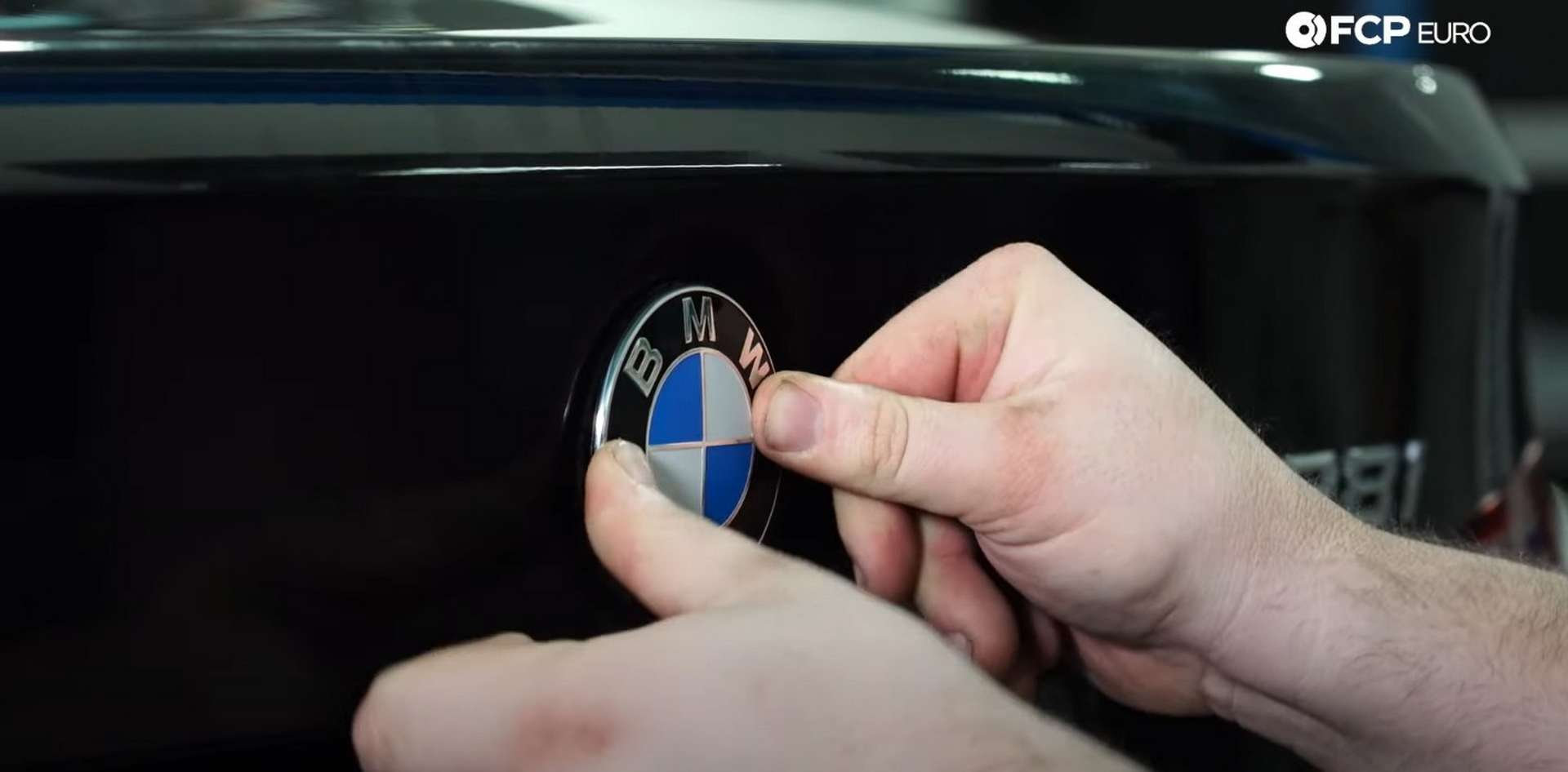 DIY BMW F30 Roundel Replacement pressing in the new emblem