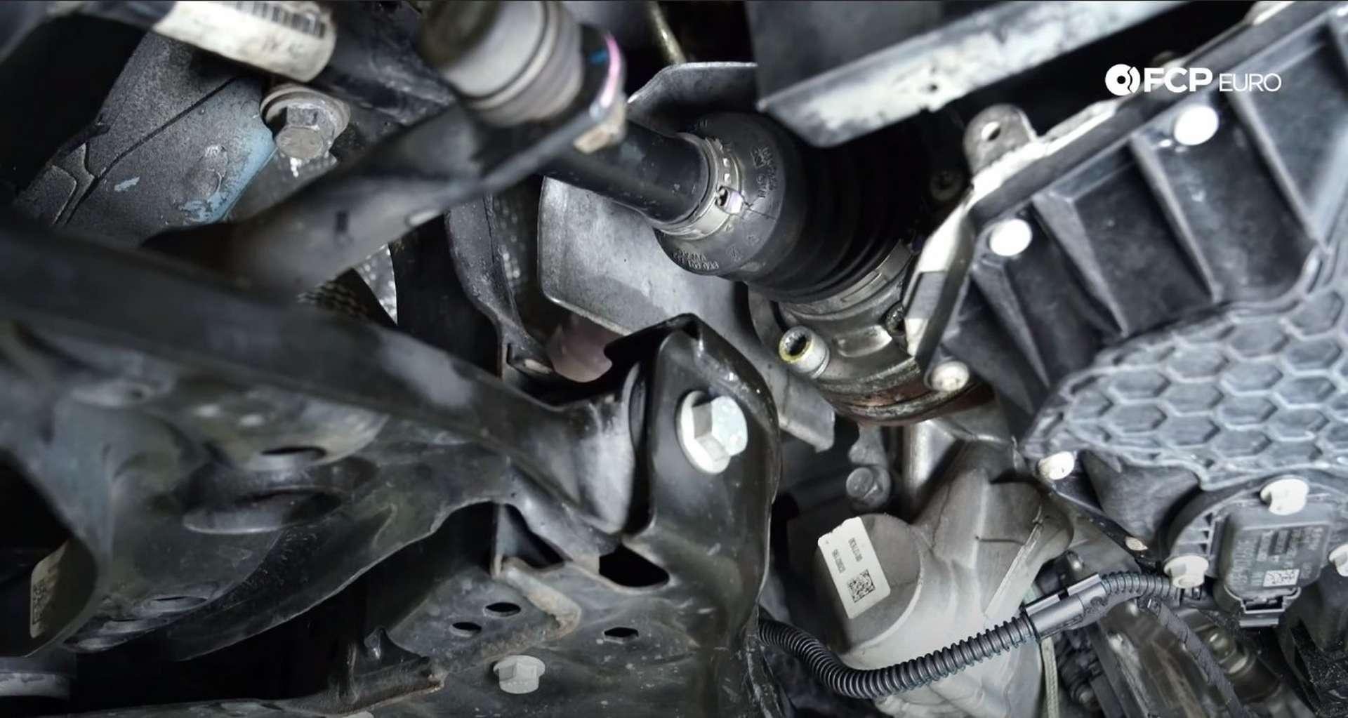 68-DIY_VW_GTI_Clutch-Job-Reinstalling-Axle-Heat-Shield