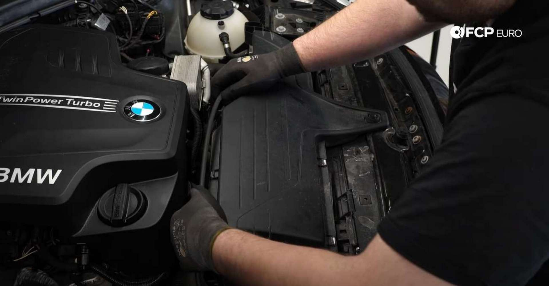 DIY BMW F30 Serpentine Belt Replacement pulling the hood cable off of the airbox