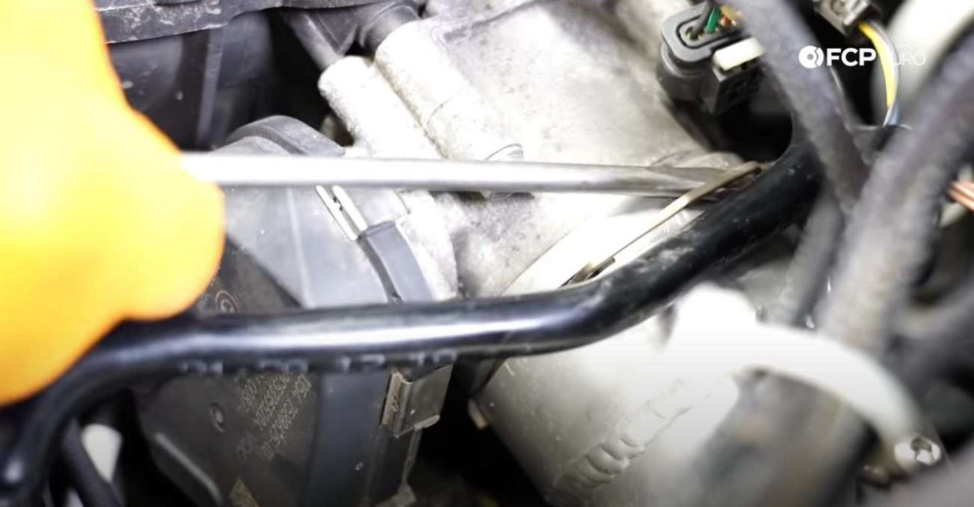 DIY BMW F30 Oil Filter Housing Gasket Replacement unlocking the charge pipe connection