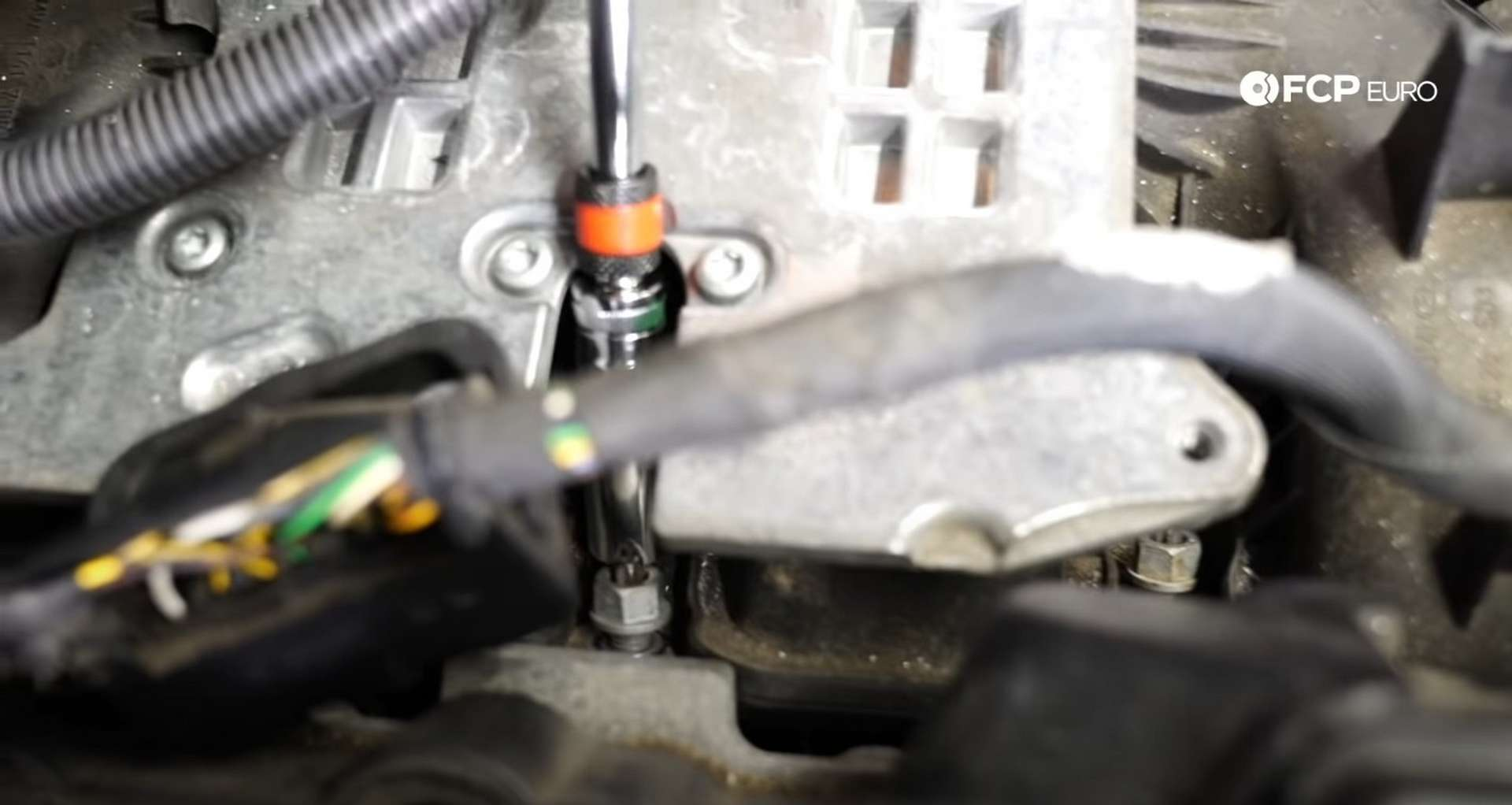 DIY BMW F30 Oil Filter Housing Gasket Replacement bolt tightening the manifold nuts