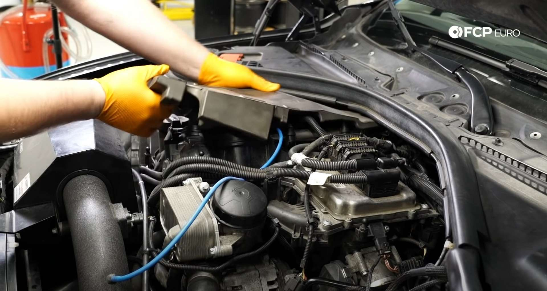 DIY BMW F30 Oil Filter Housing Gasket Replacement fitting the acoustic insulation to the valve cover