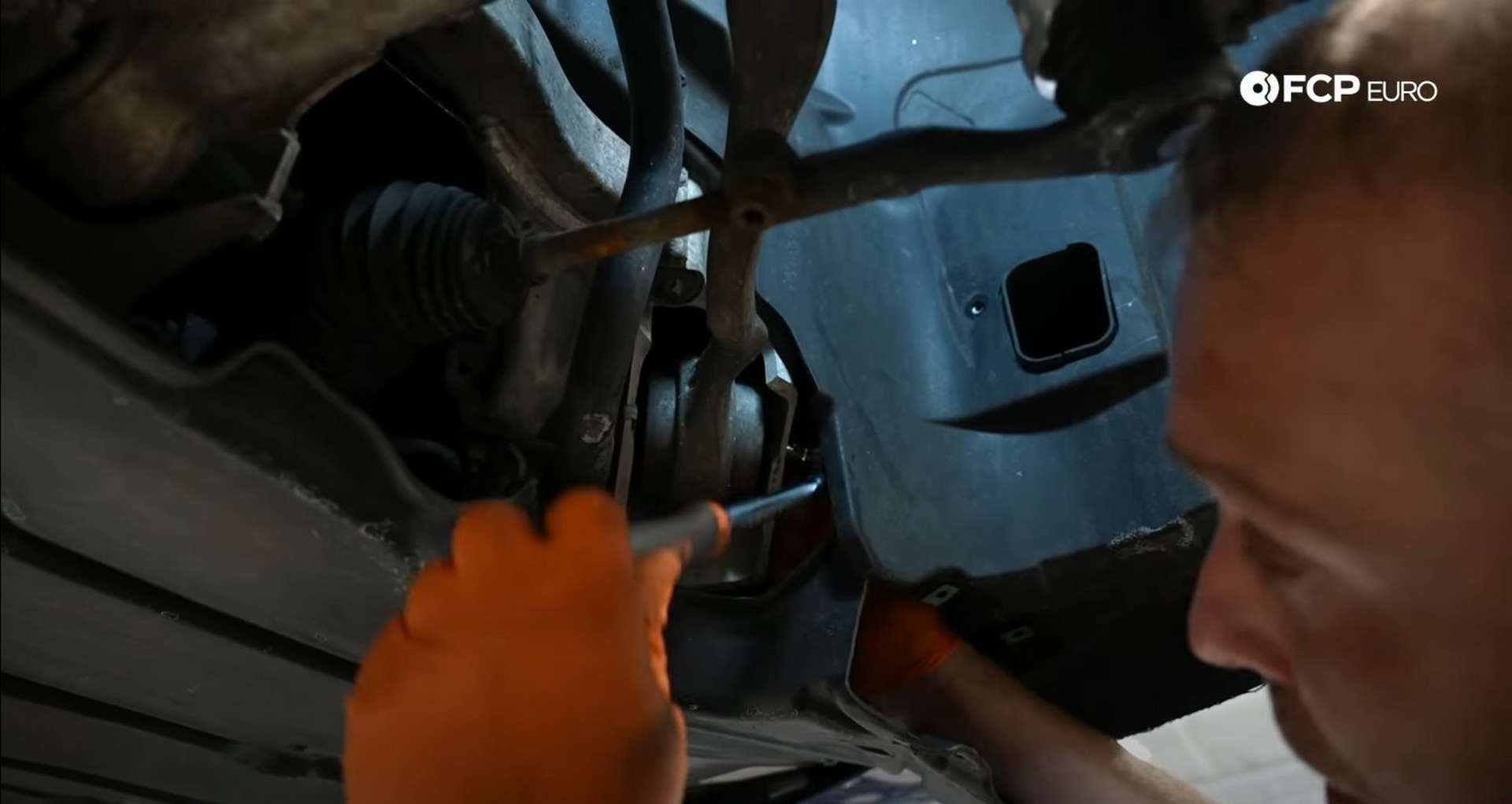 DIY BMW E9X Front Control Arm Upgrade removing the tension rod's inner mounting bolt