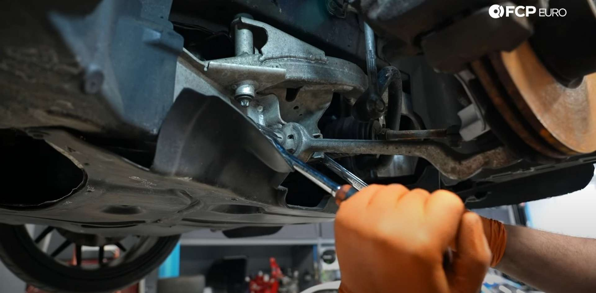 DIY BMW E9X Front Control Arm Upgrade removing the control arm's inner mounting bolt