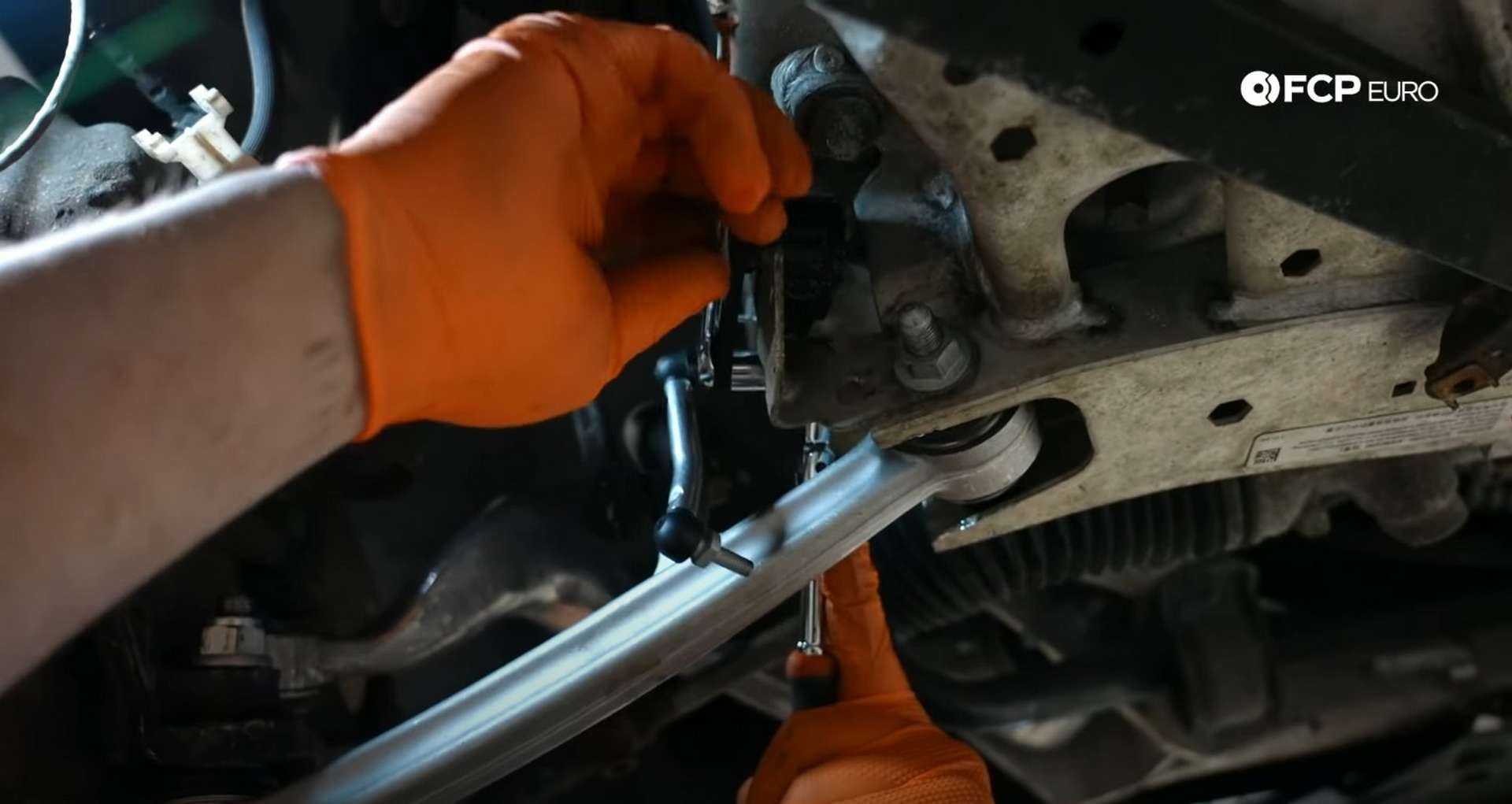 DIY BMW E9X Front Control Arm Upgrade tightening the headlight leveling arm