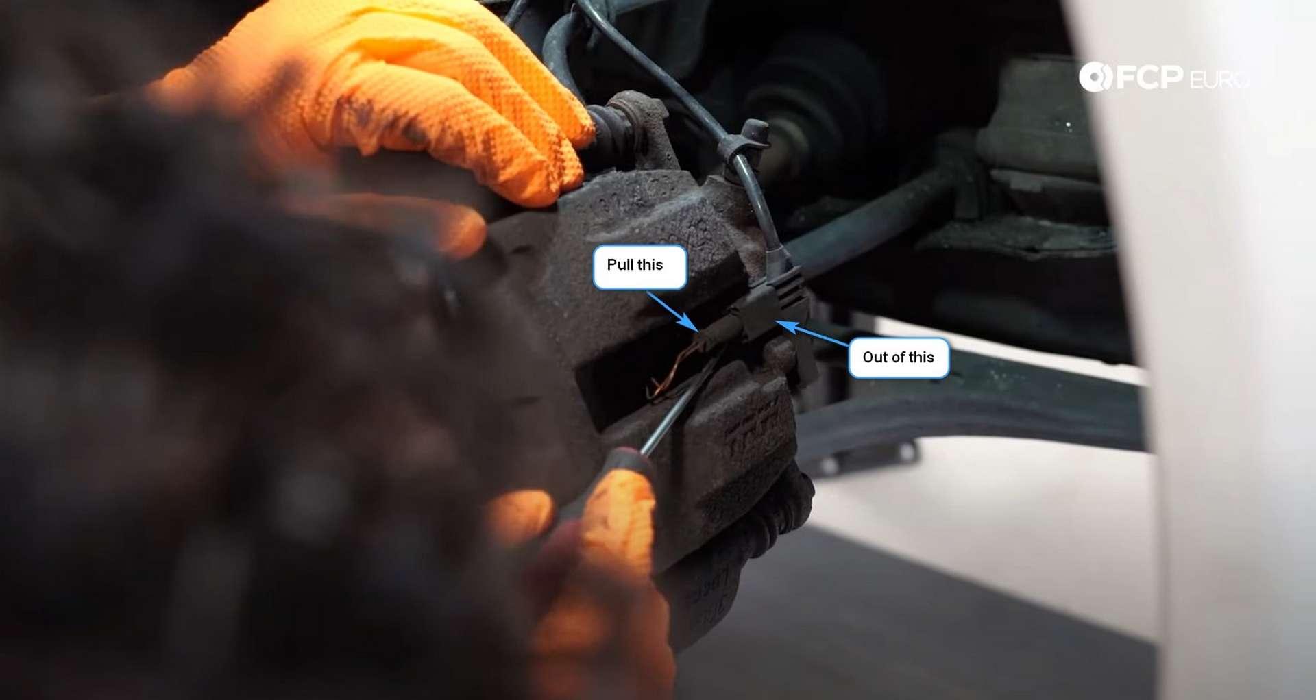 DIY Mercedes W203 Front Brake Service removing the pad wear sensor
