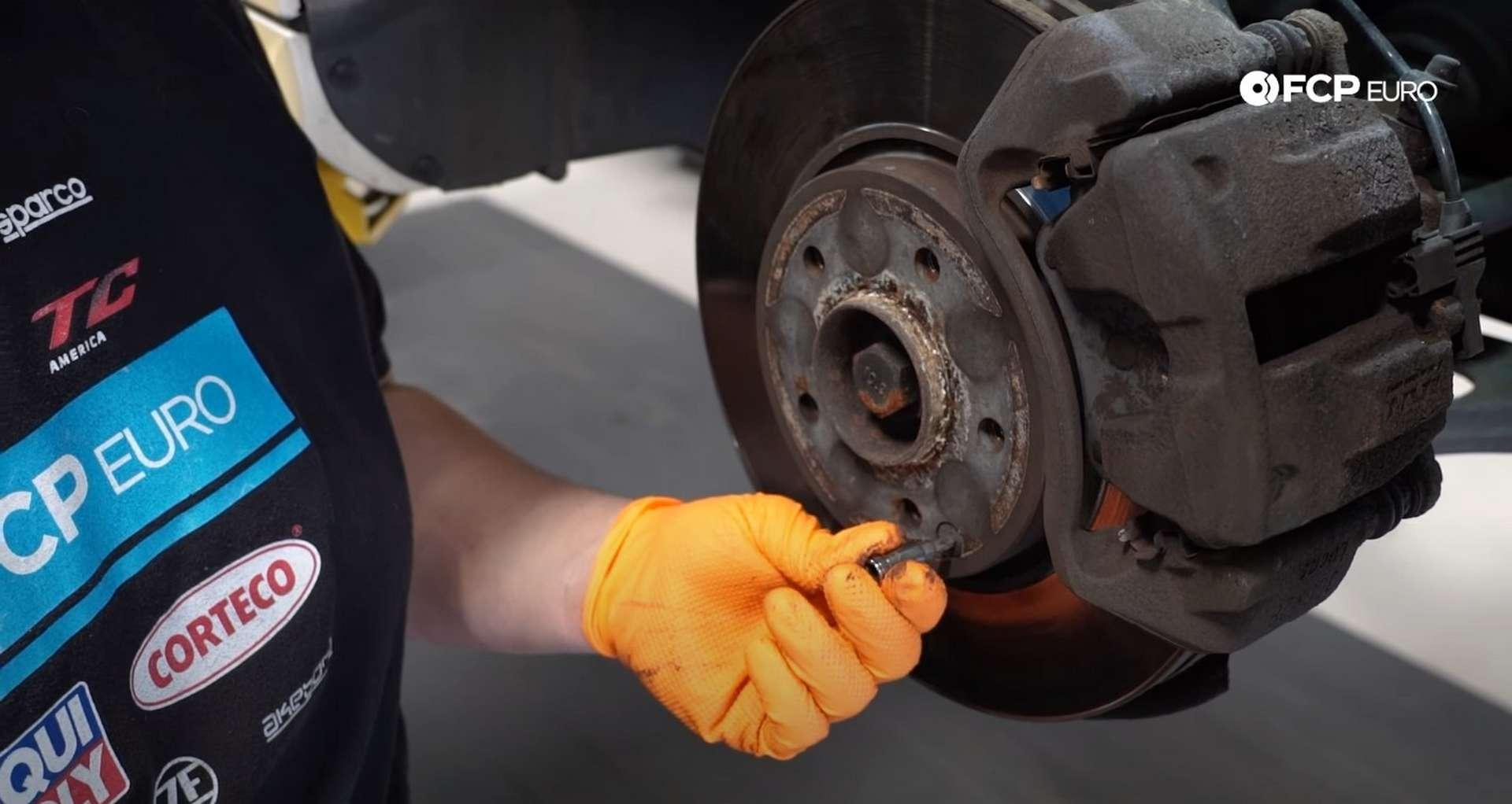 DIY Mercedes W203 Front Brake Service removing the set screw