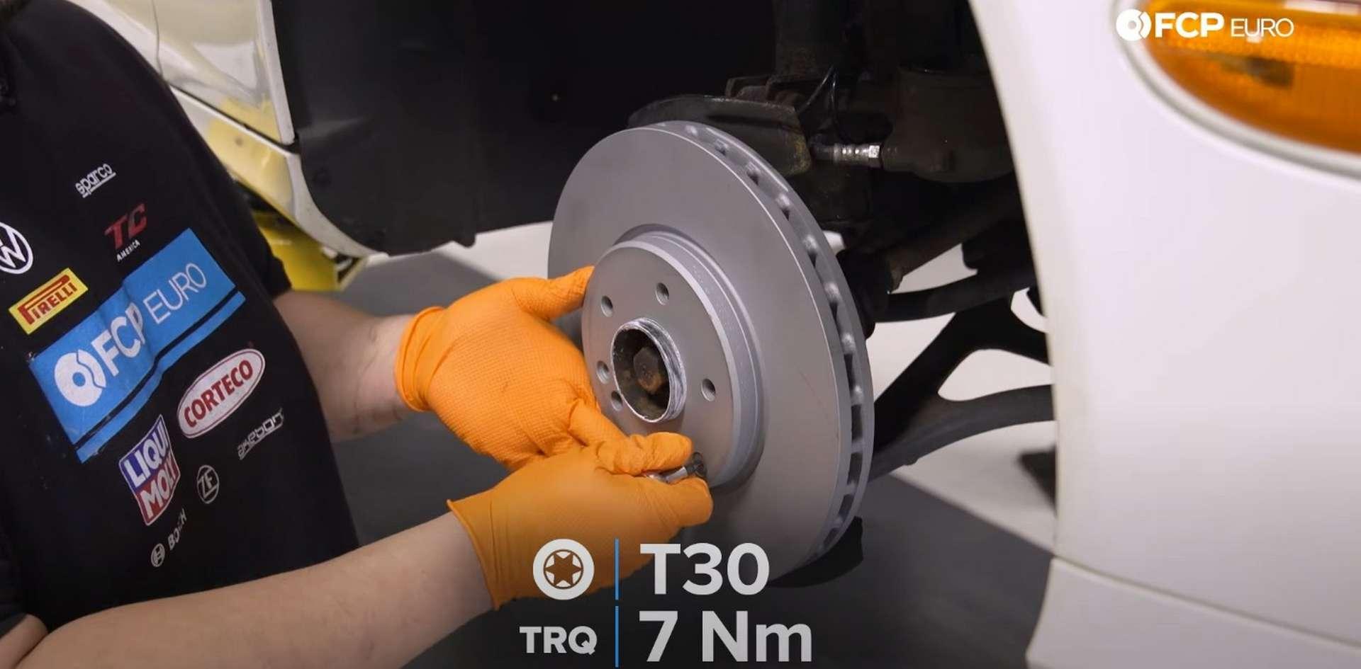DIY Mercedes W203 Front Brake Service tightening the rotor's set screw