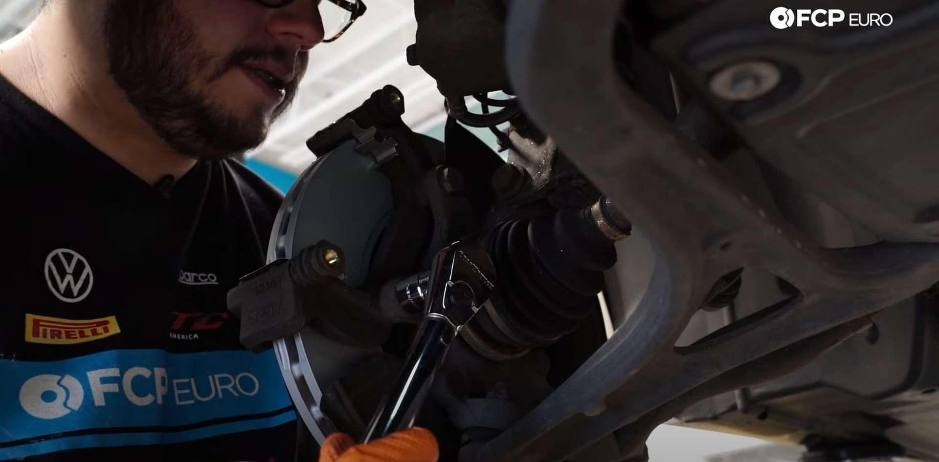 DIY Mercedes W203 Front Brake Service torquing the caliper bracket