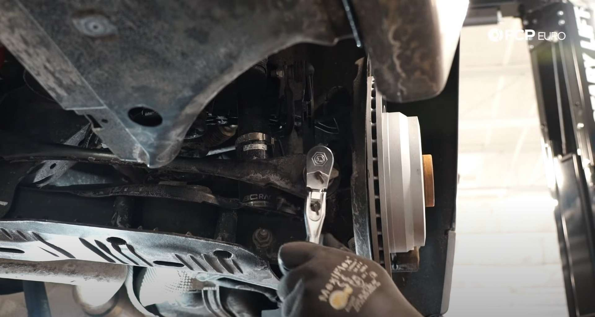 DIY BMW F30 Rear Control Arm Replacement removing outer toe link bolt