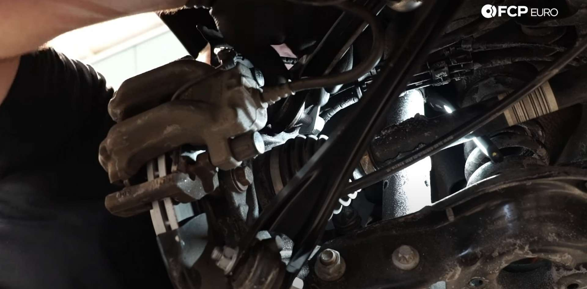 DIY BMW F30 Rear Control Arm Replacement installing the outer bolt