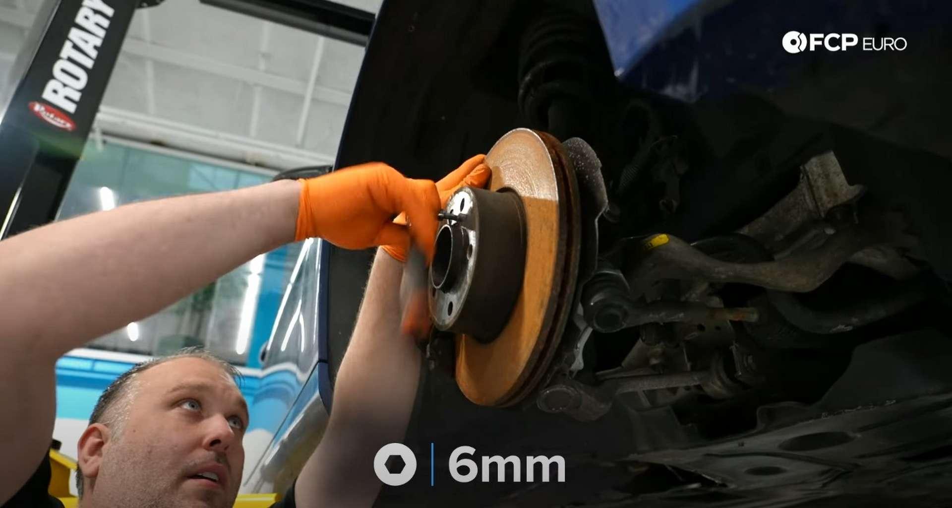 DIY BMW E9X Wheel Bearing Replacement removing the set screw