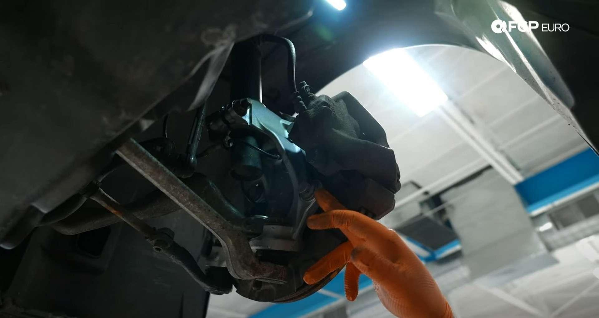DIY BMW E9X Wheel Bearing Replacement caliper mounting bolt location