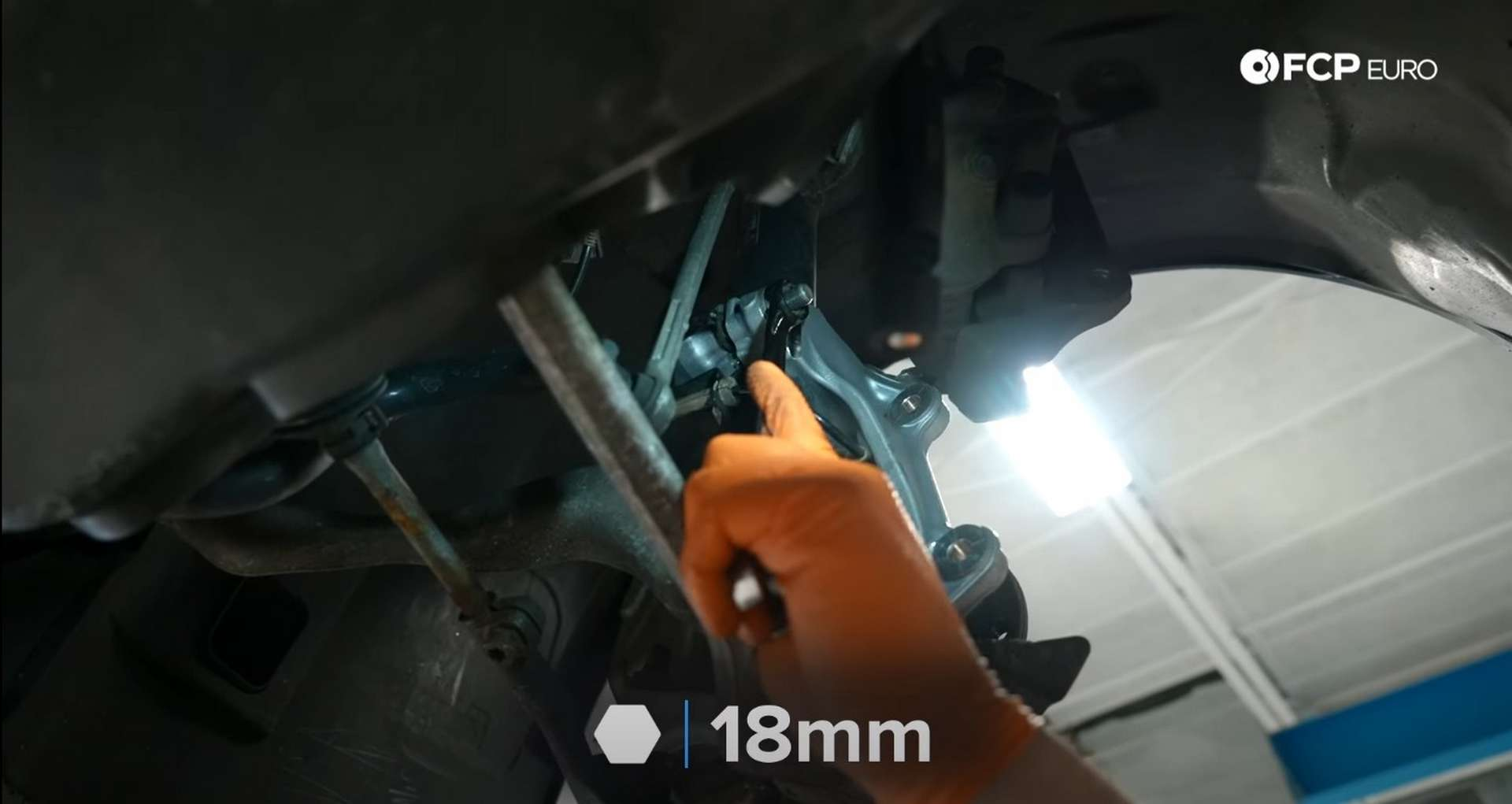 DIY BMW E9X Wheel Bearing Replacement removing the strut's pinch bolt