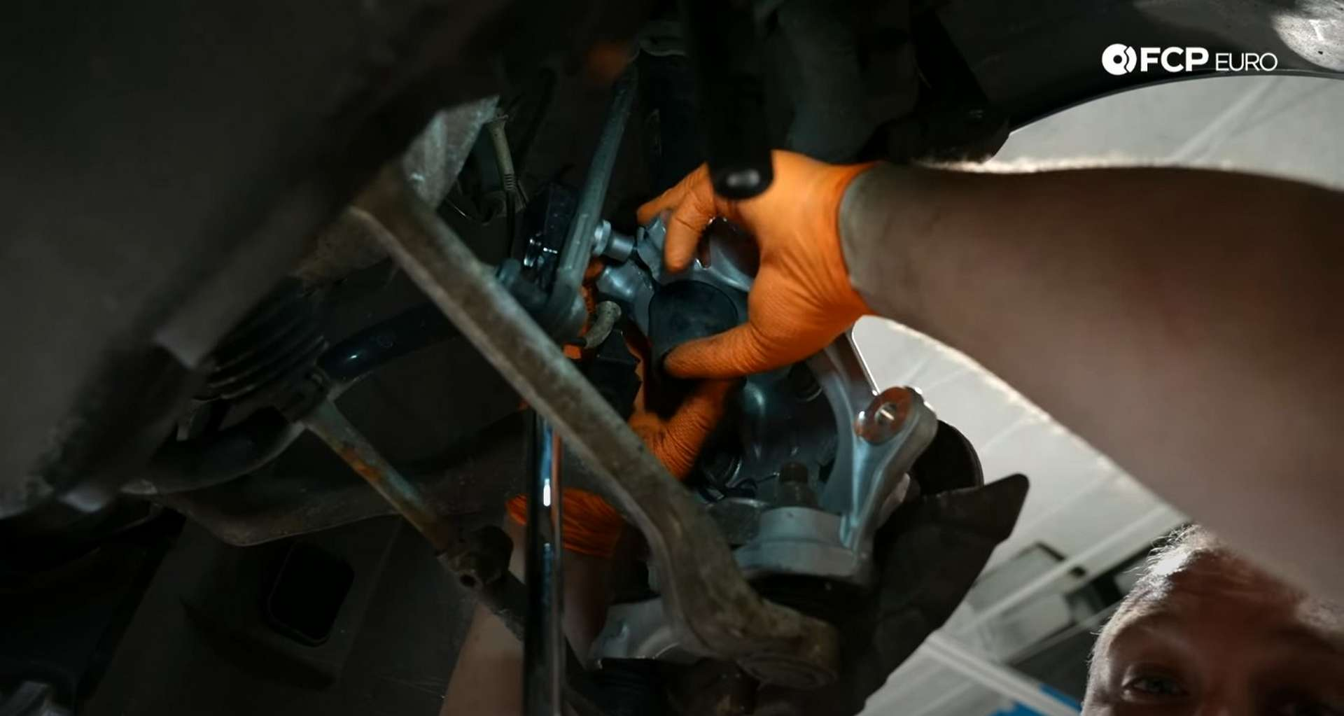 DIY BMW E9X Wheel Bearing Replacement pulling down on the knuckle