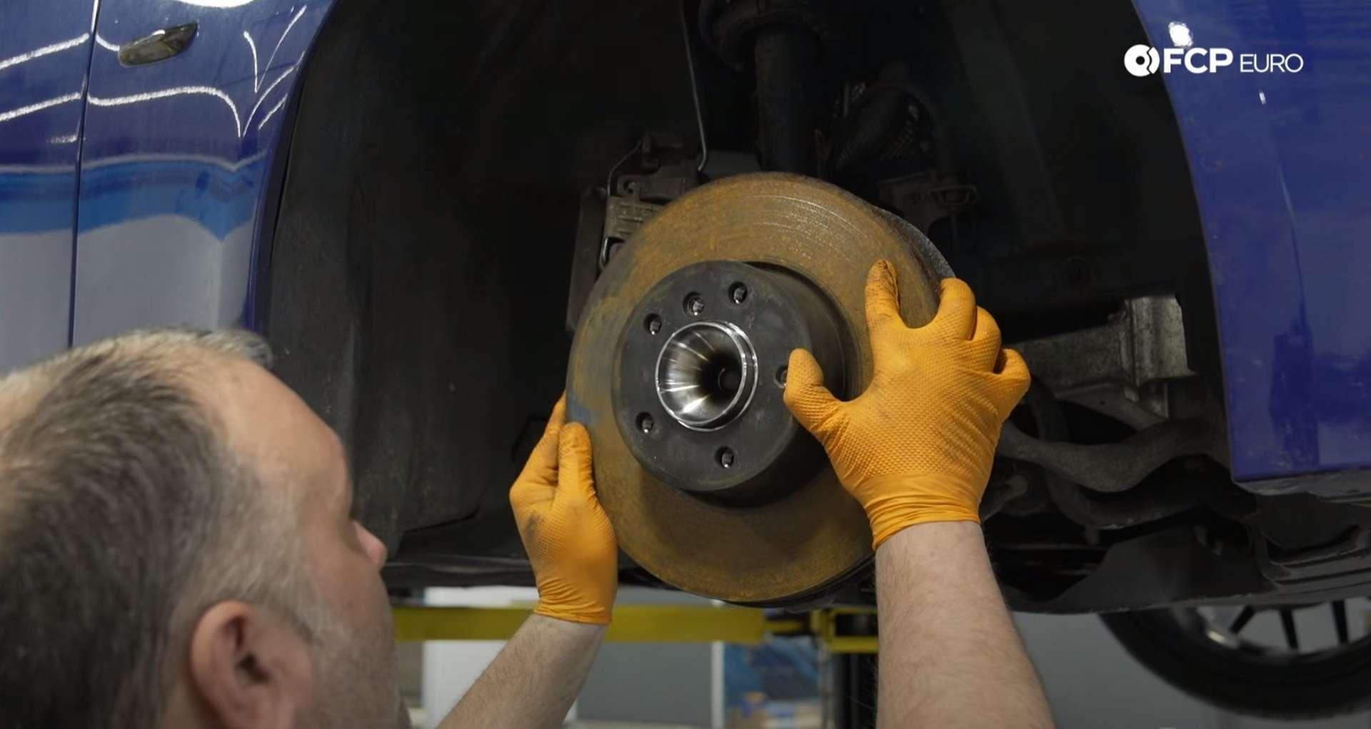 DIY BMW E9X Wheel Bearing Replacement refitting the brake rotor