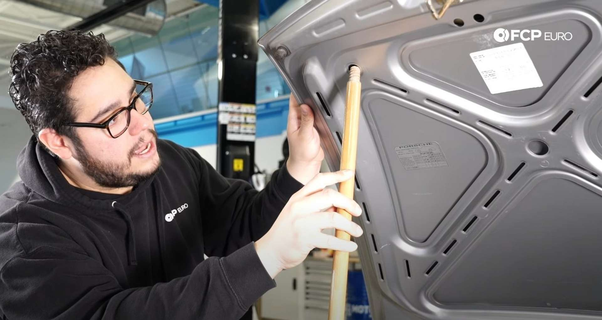 DIY Porsche 996 911 Hood and Engine Lid Strut Replacement propping up the hood