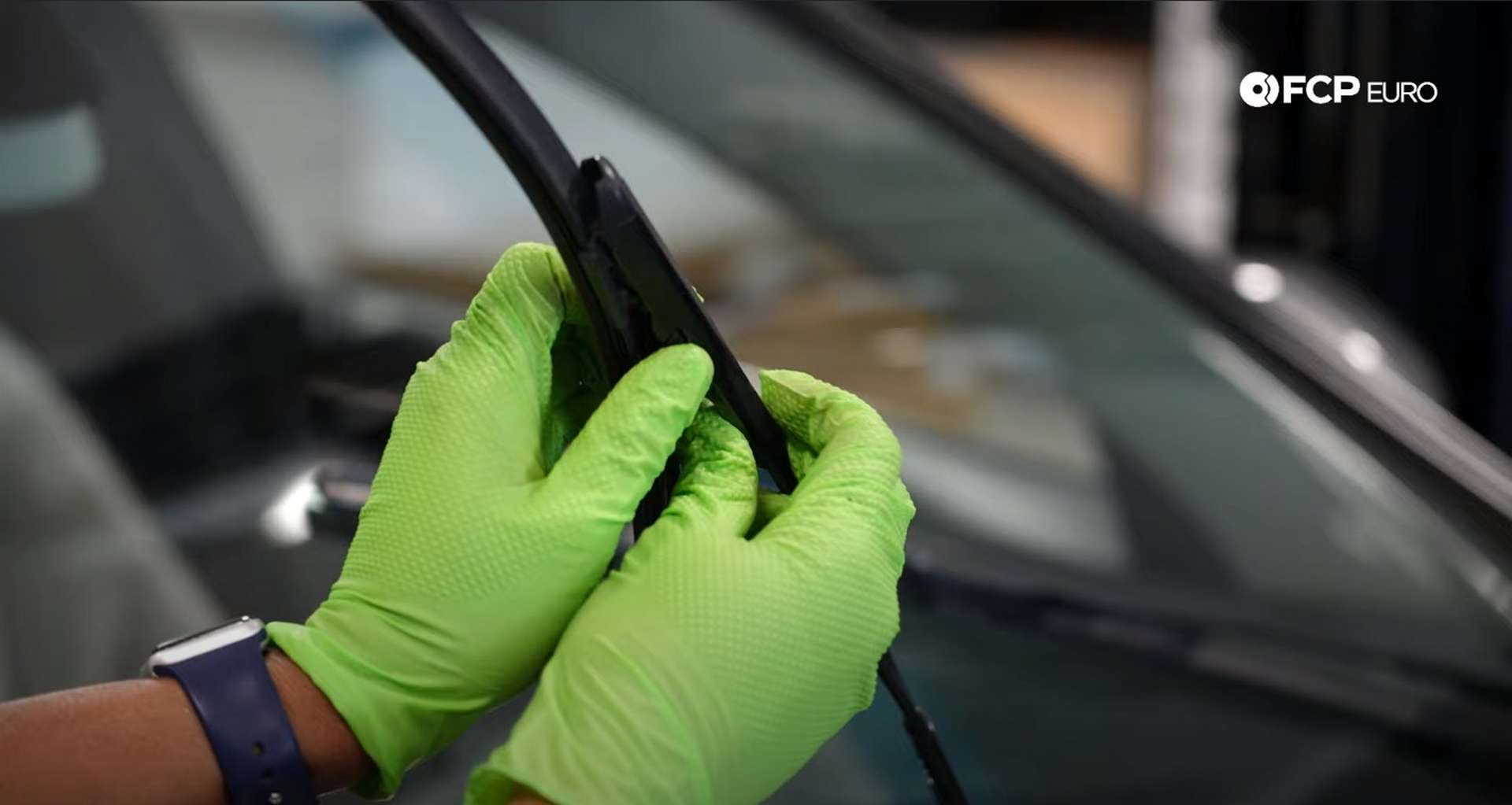 DIY Mercedes-Benz W205 Wiper Blade Replacement pressing the tabs to release the arm