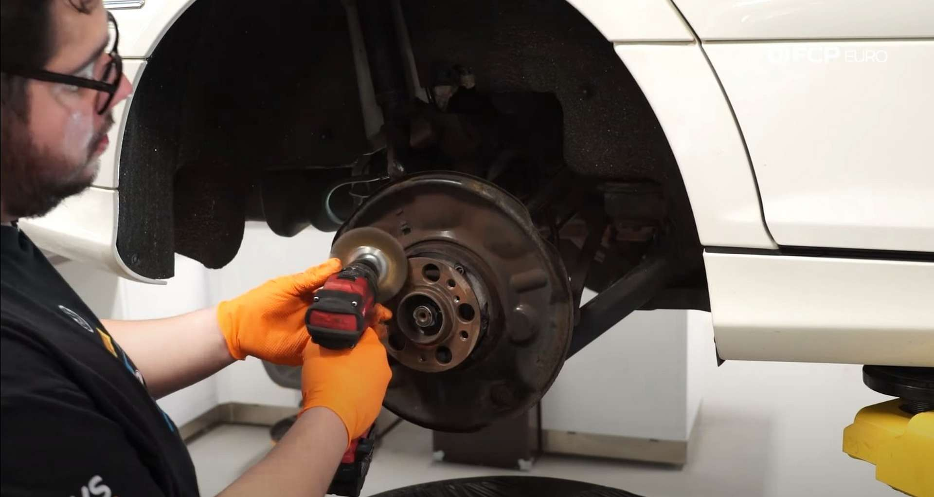 DIY Mercedes-Benz W302 Rear Brake Service caliper cleaning the mounting surface