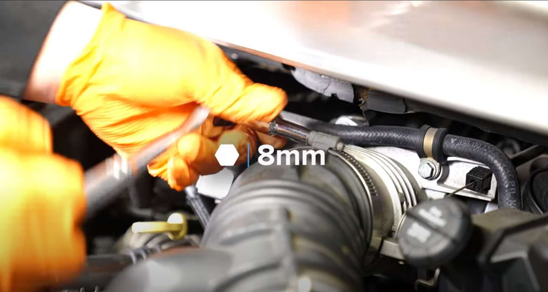 Porsche 996 Water Pump And Thermostat Replacement loosening the intake hose clamp on the throttle body