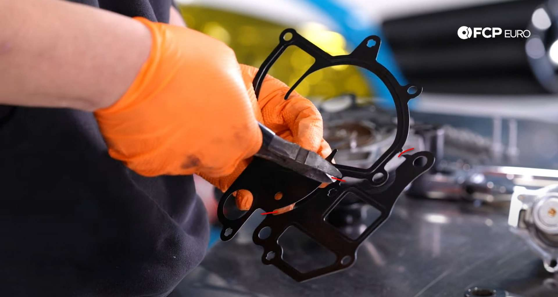 DIY Porsche 996 911 Water Pump And Thermostat Replacement cutting the water pump gasket