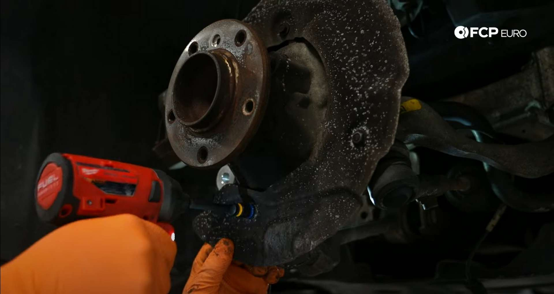 DIY BMW E90 Steering Knuckle Replacement caliper removing the dust shield