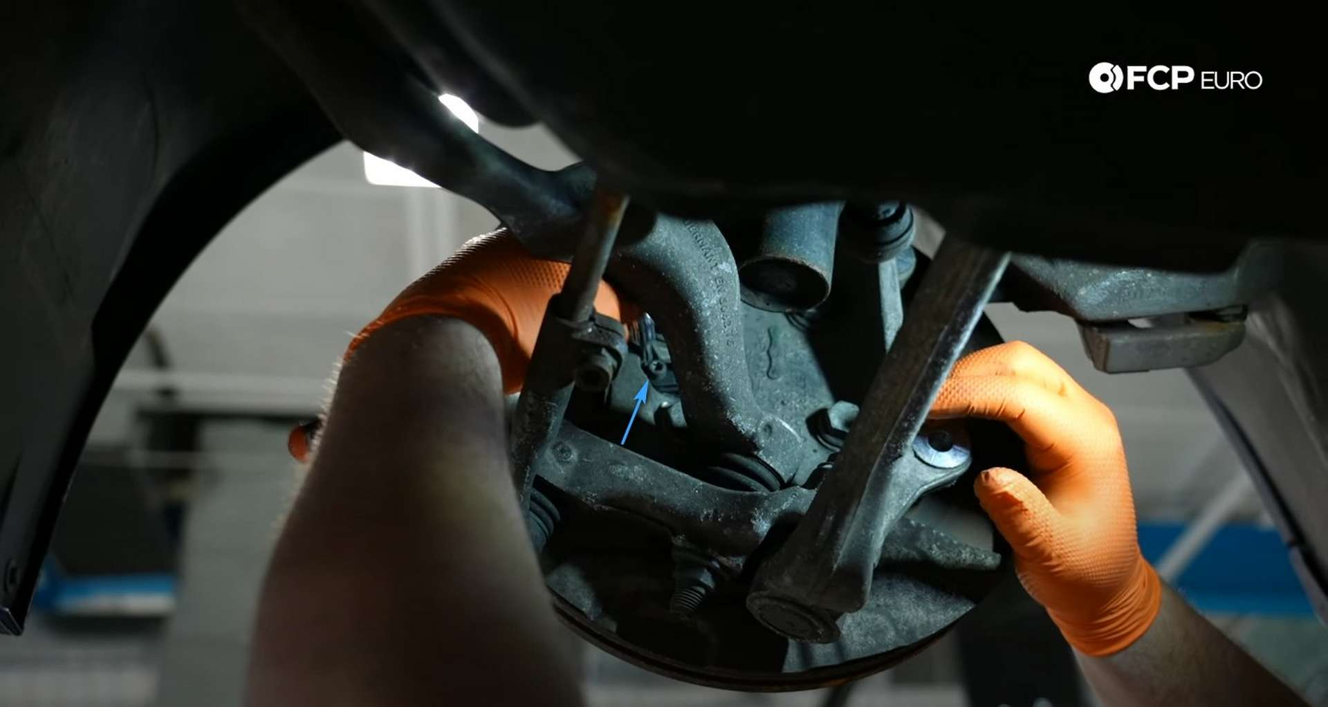 DIY BMW E90 Steering Knuckle Replacement removing the wheel speed sensor