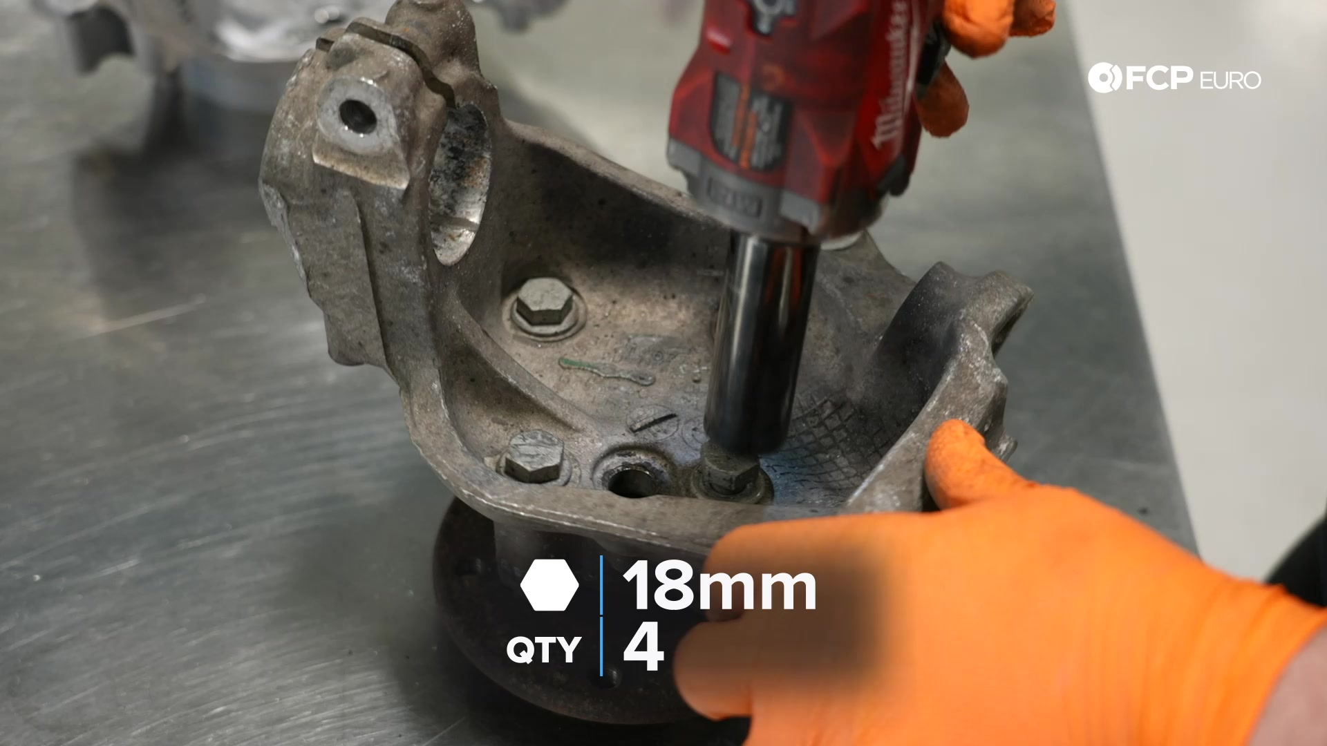 DIY BMW E90 Steering Knuckle Replacement removing the wheel bearing from the old knuckle