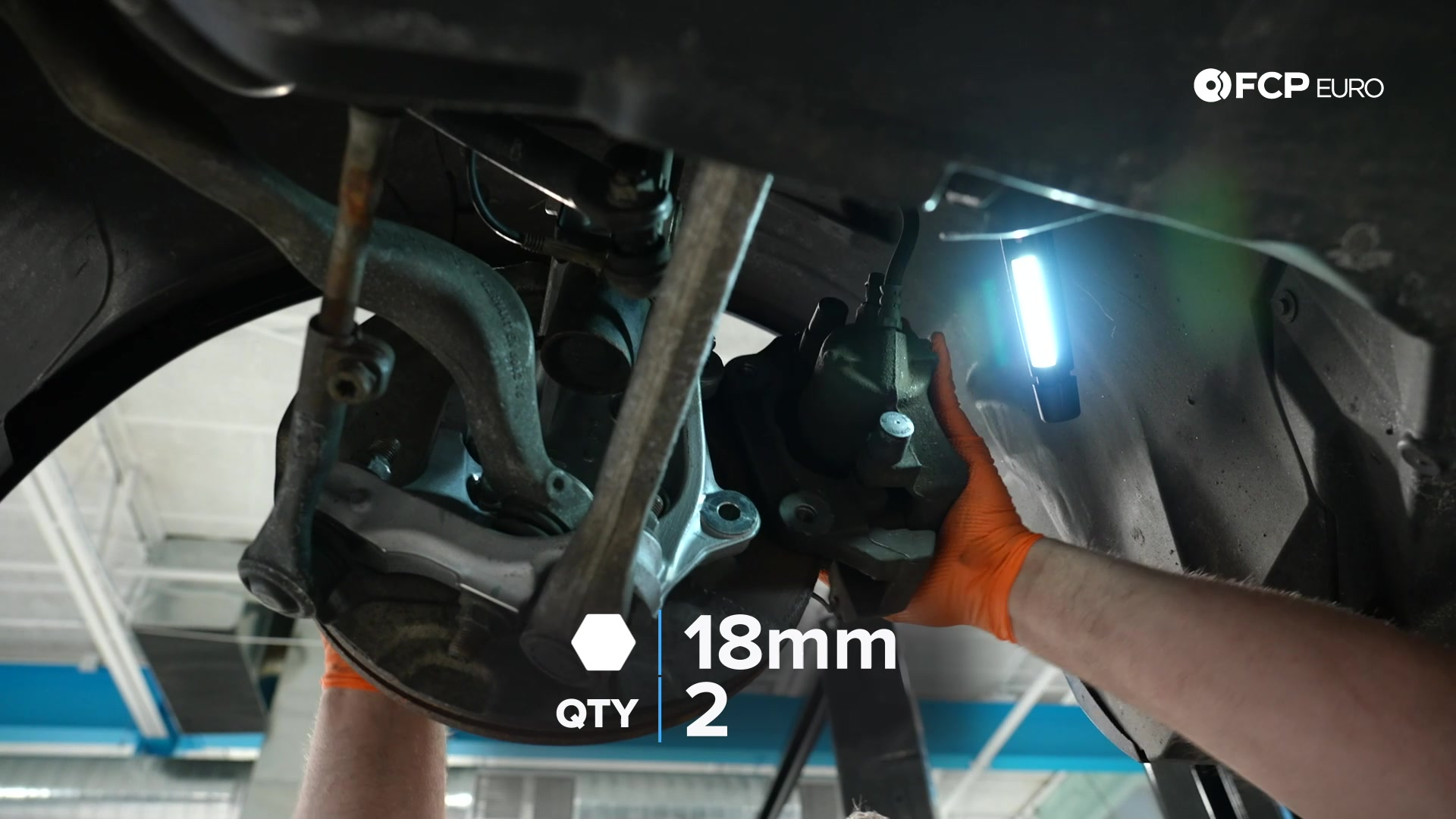DIY BMW E90 Steering Knuckle Replacement tightening the dust shield's bolts