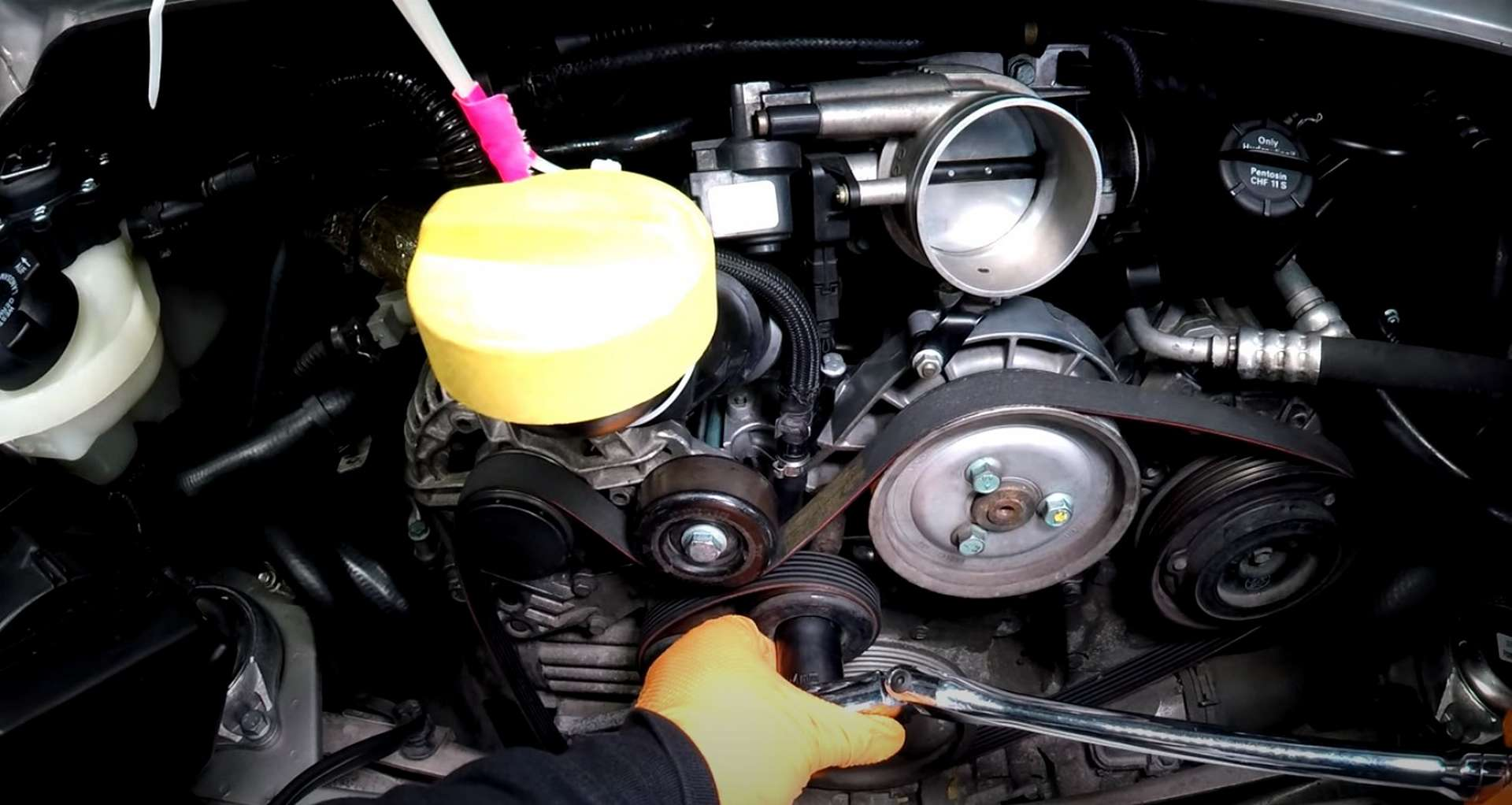 Porsche 996 Accessory Belt Drive System Replacement removing the old belt