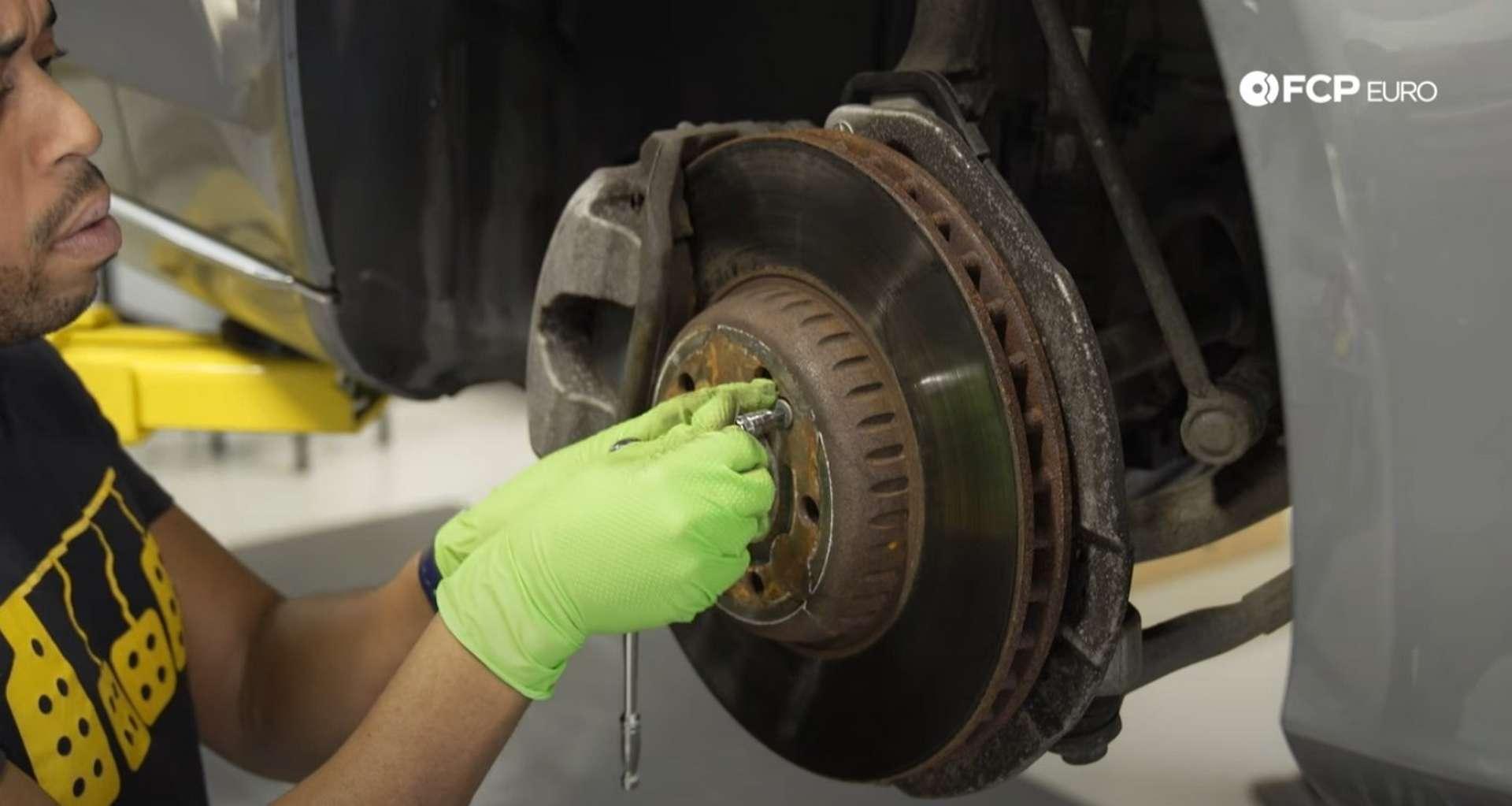 DIY Mercedes-Benz W205 Front Brake Service removing the set screw