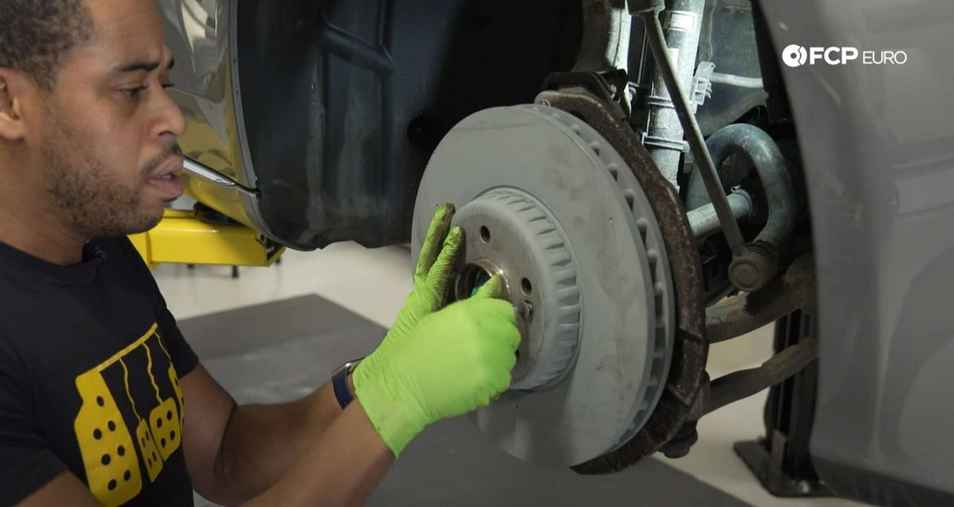DIY Mercedes-Benz W205 Front Brake Service installing the new rotor and set screw