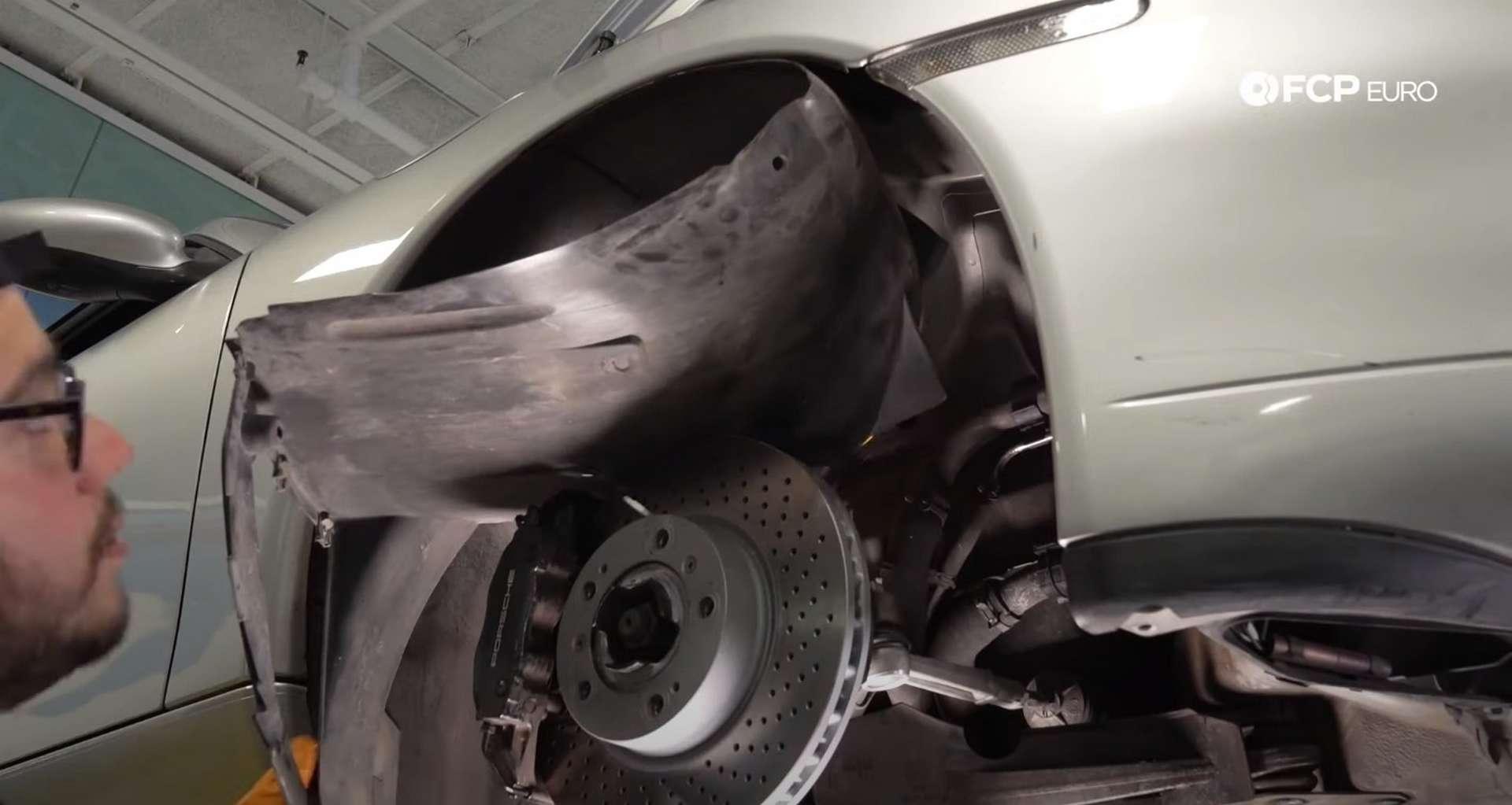 DIY Porsche 996 Radiator Replacement tucking the fender liner back