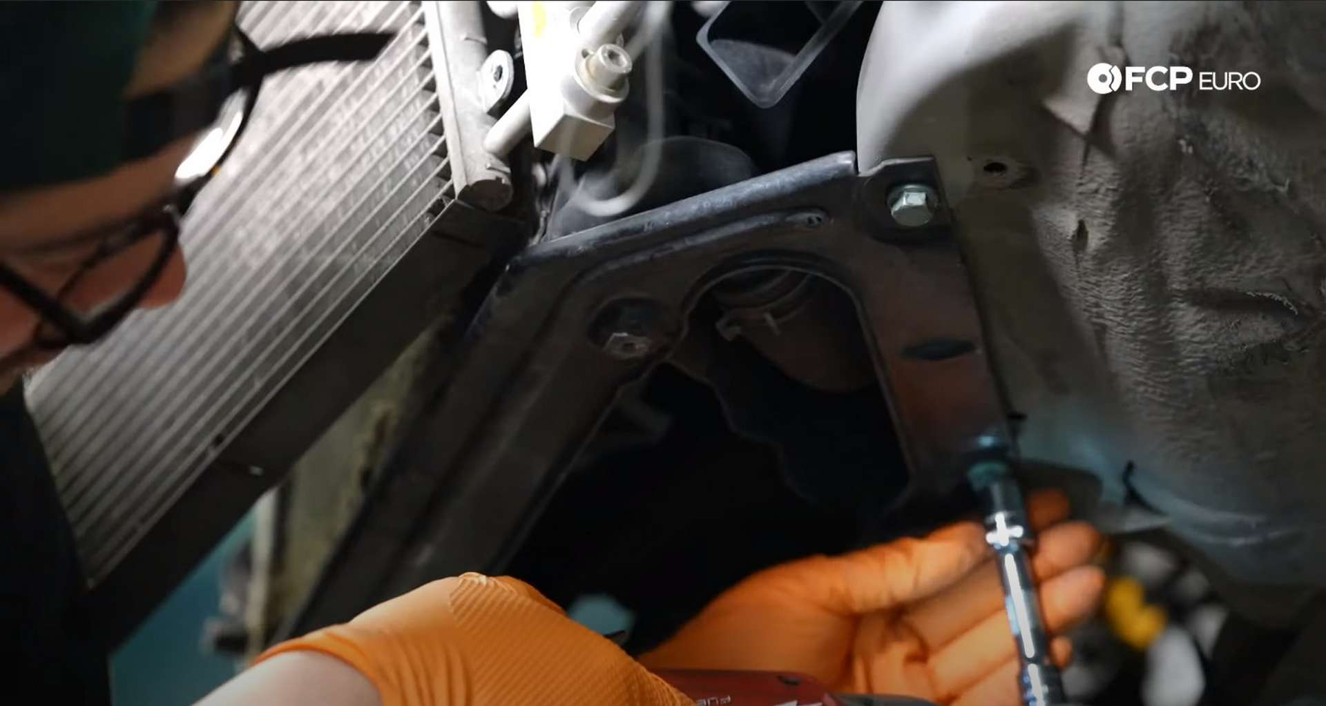 DIY Porsche 996 Radiator Replacement removing lower fan bracket screws