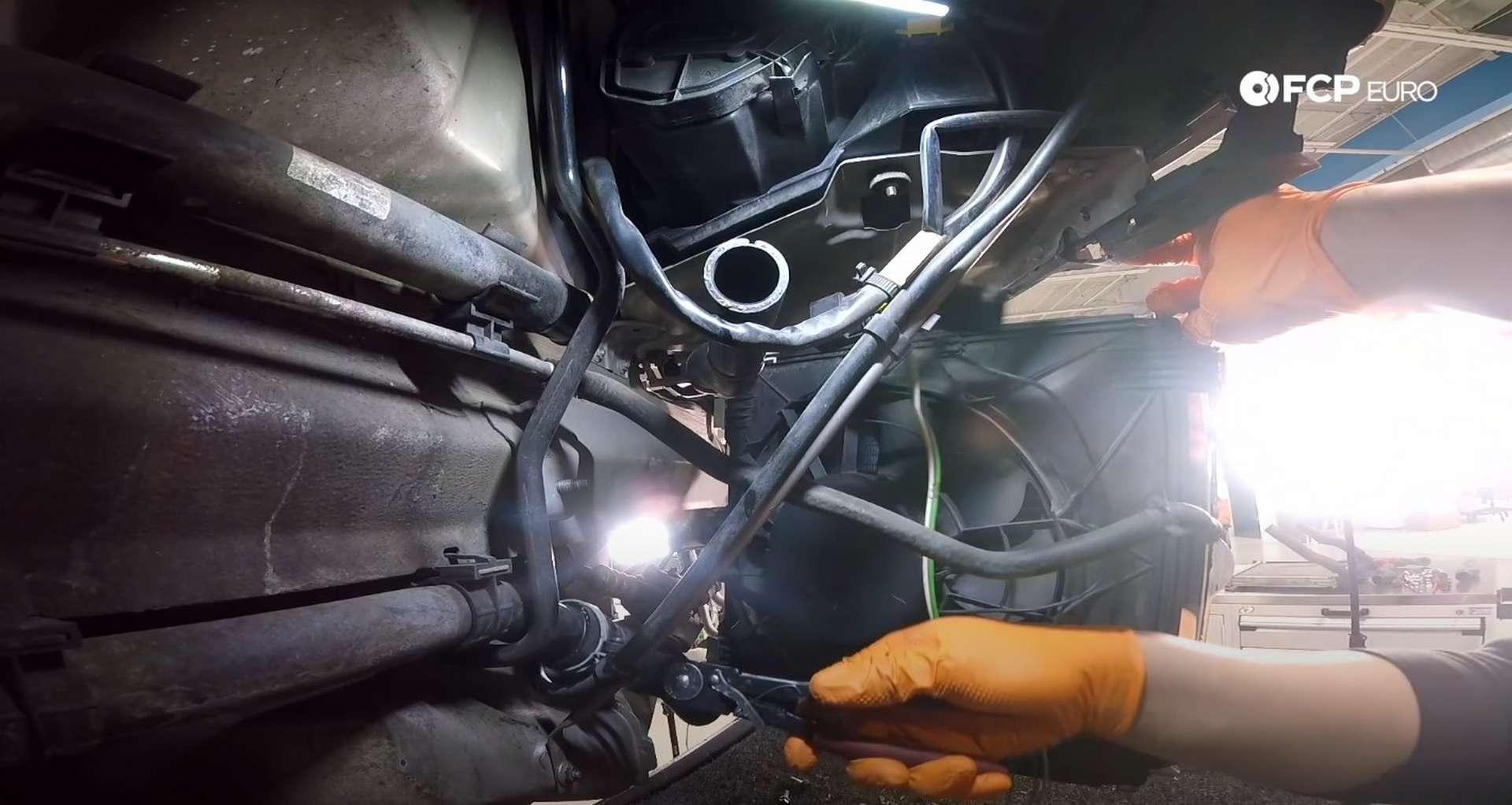 DIY Porsche 996 Radiator Replacement installing the new radiator