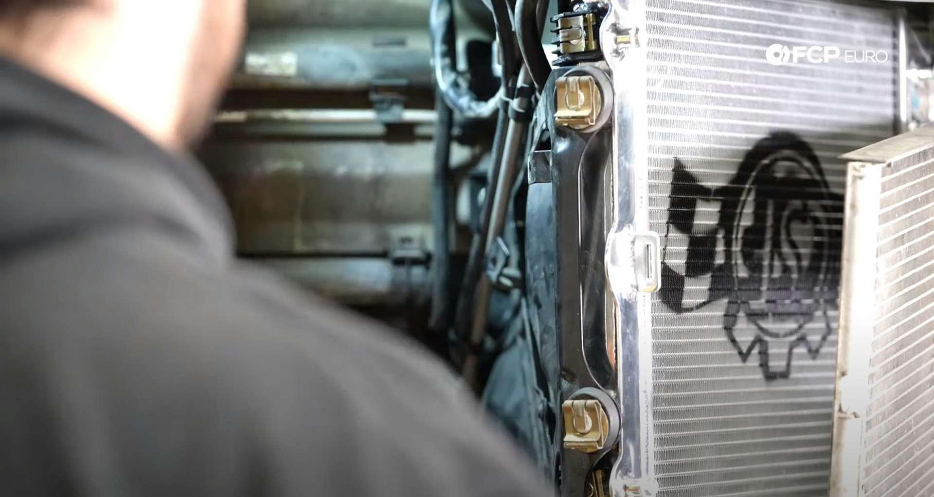 DIY Porsche 996 Radiator Replacement installed rad bracket retaining clips