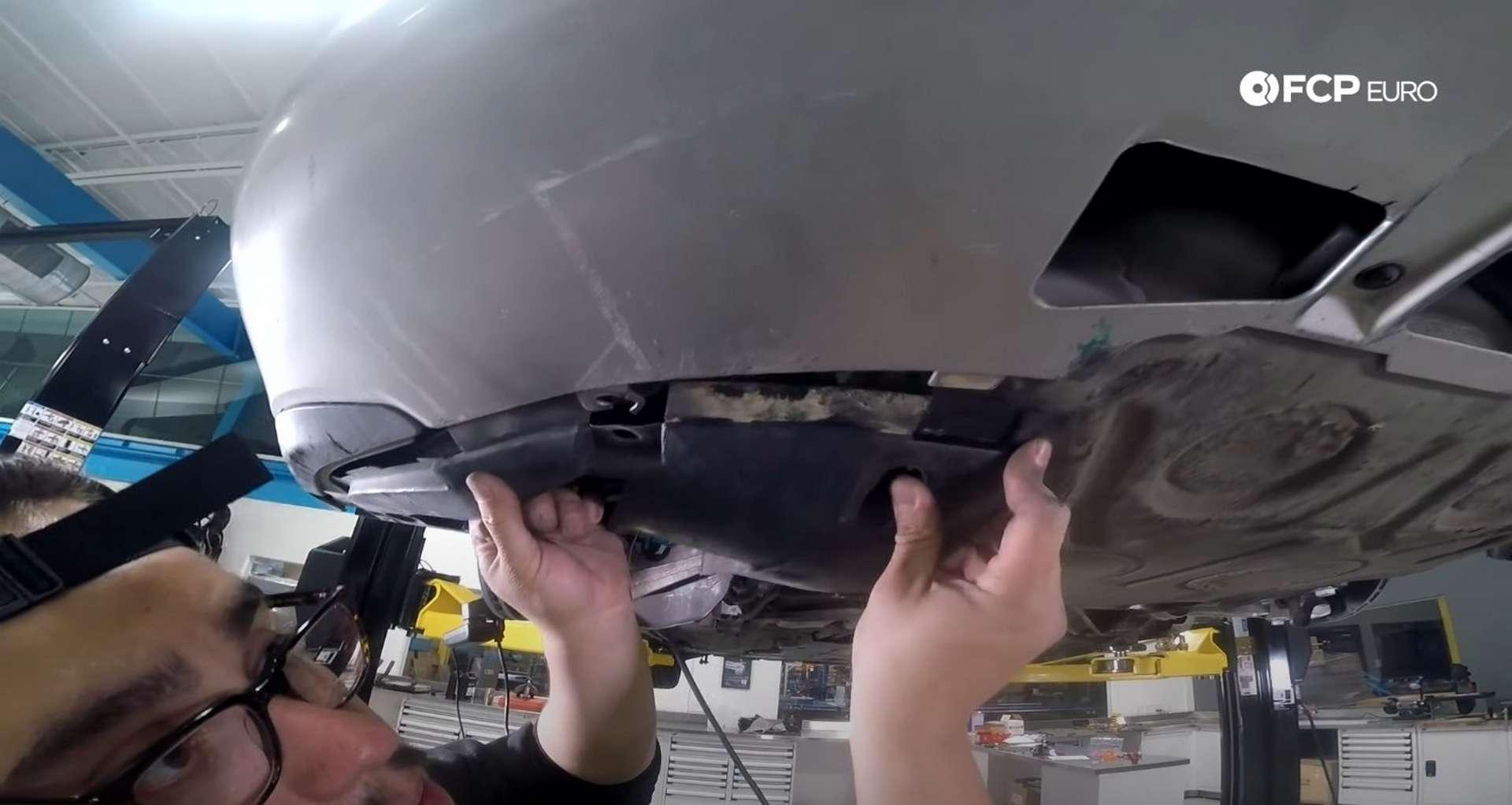DIY Porsche 996 Radiator Replacement aligning the fender liner