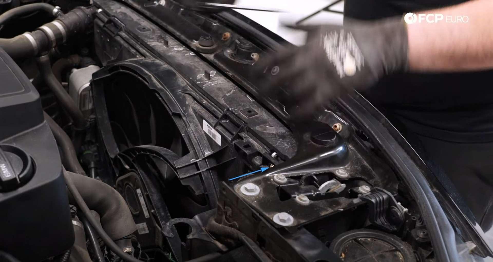 DIY BMW F30 Radiator Replacement loosening removing the transmission oil cooler fastener