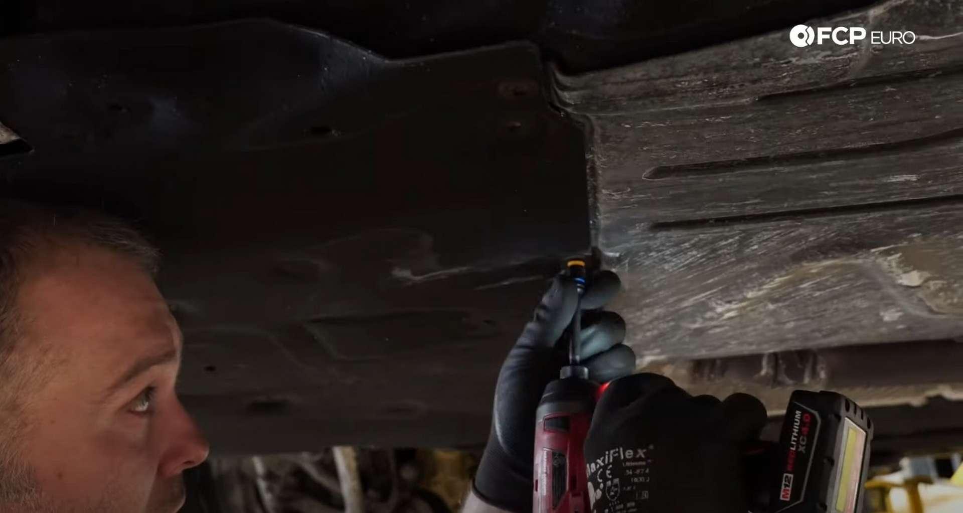 DIY BMW F30 Radiator Replacement loosening removing the upper radiator fastener