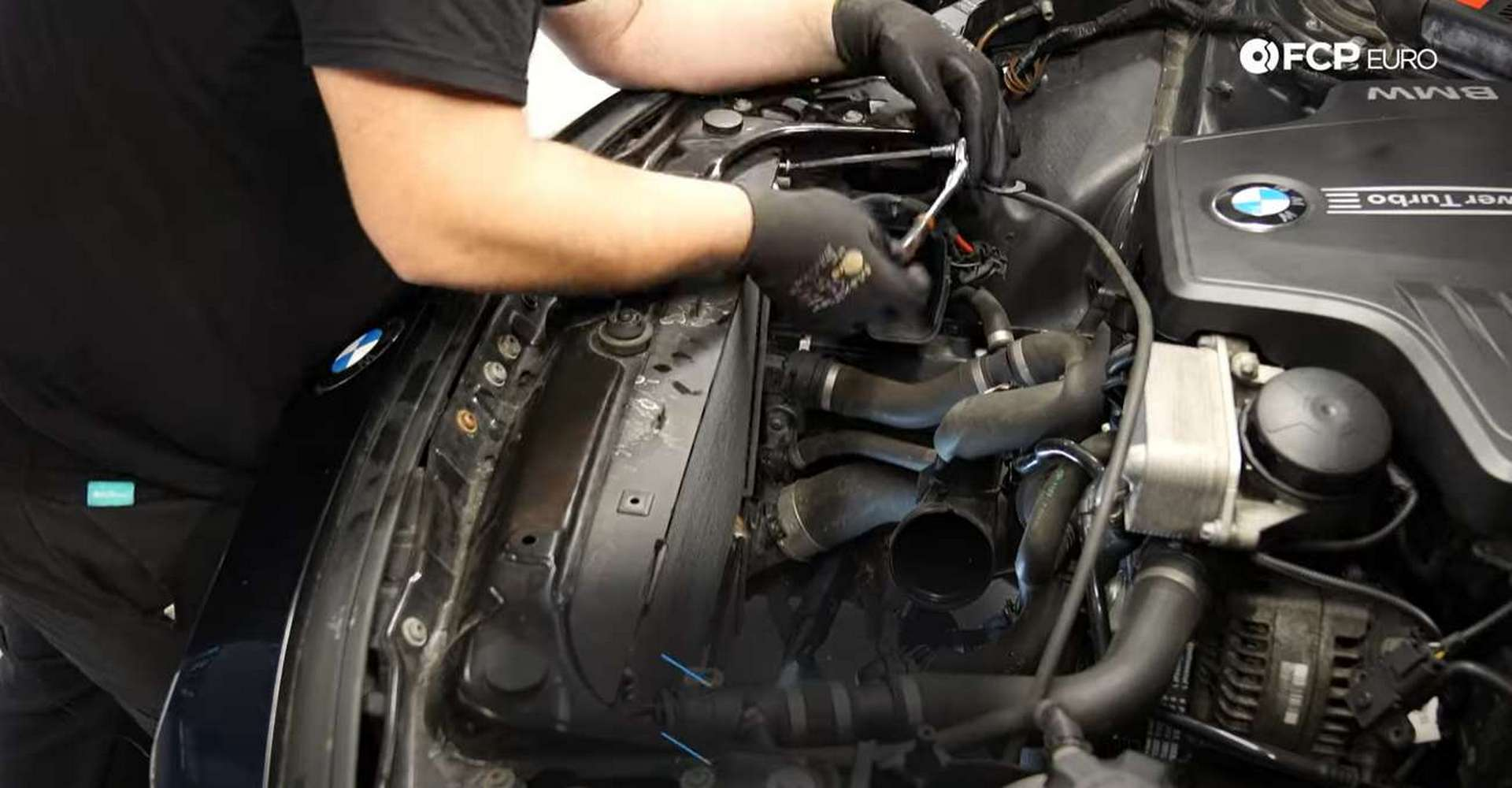 DIY BMW F30 Radiator Replacement loosening the water pump's hose clamp