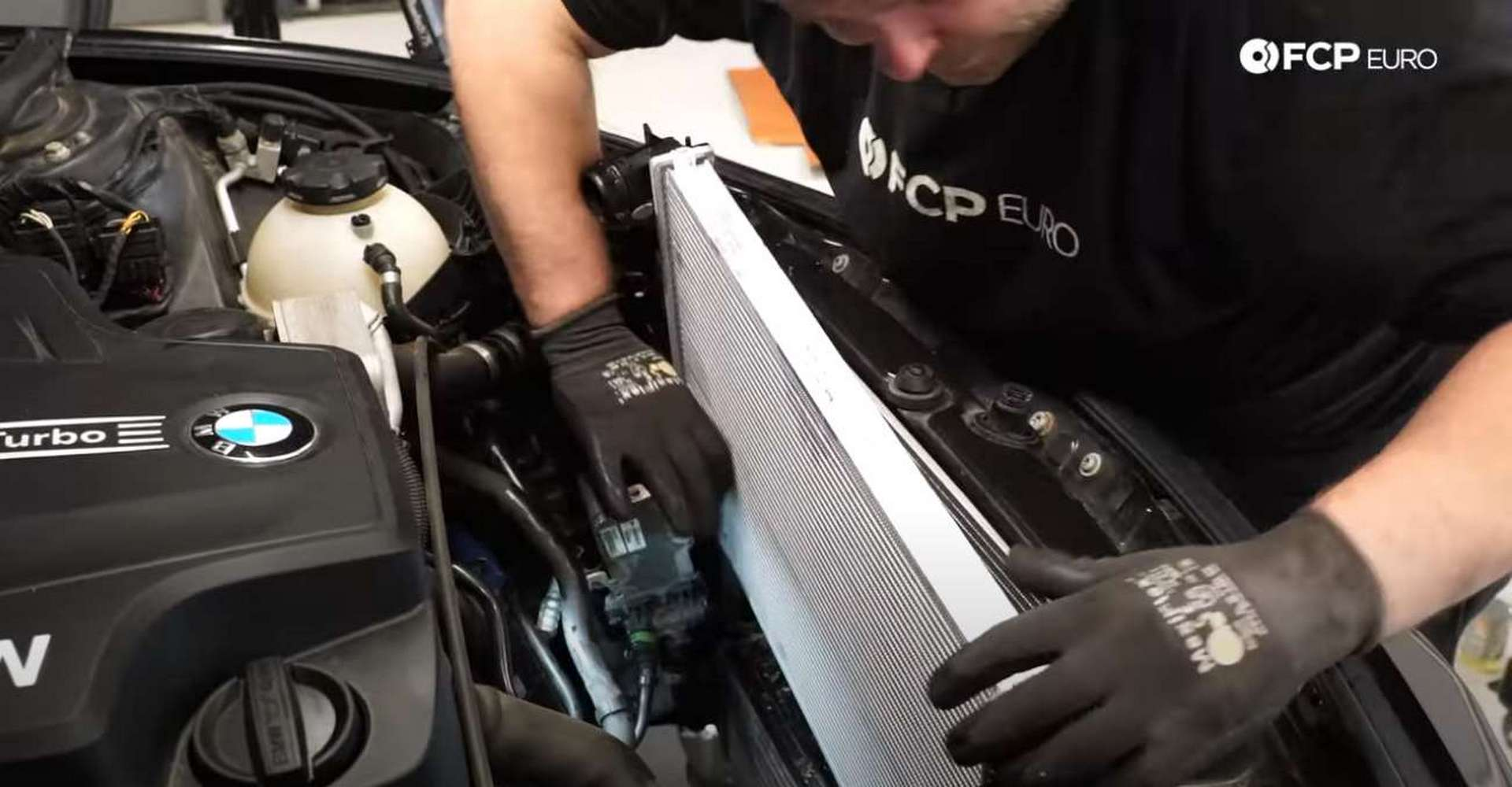 DIY BMW F30 Radiator Replacement installing the radiator