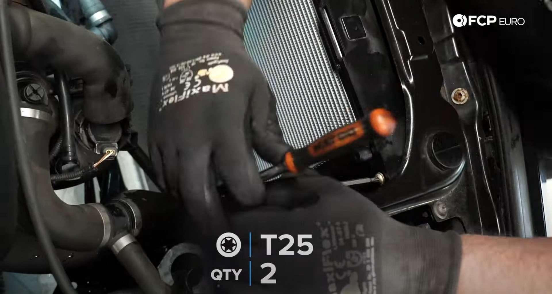 DIY BMW F30 Radiator Replacement installing the radiator mounting plate